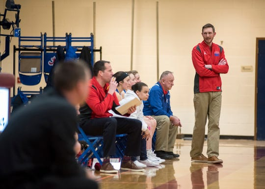 St. Clair High School basketball coach Mike Boullard turns to address his team while watching their game against Marine City High School Friday, Feb. 8, 2019 at St. Clair High School.