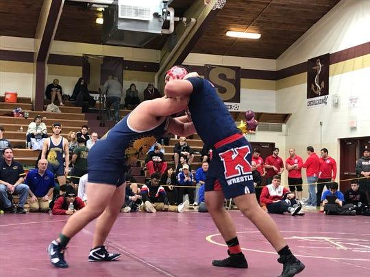 Roy C. Ketcham's Chris Vanderlinde wrestles Mahopac's Joe Harney in the Section 1 Division I quarterfinals Saturday.