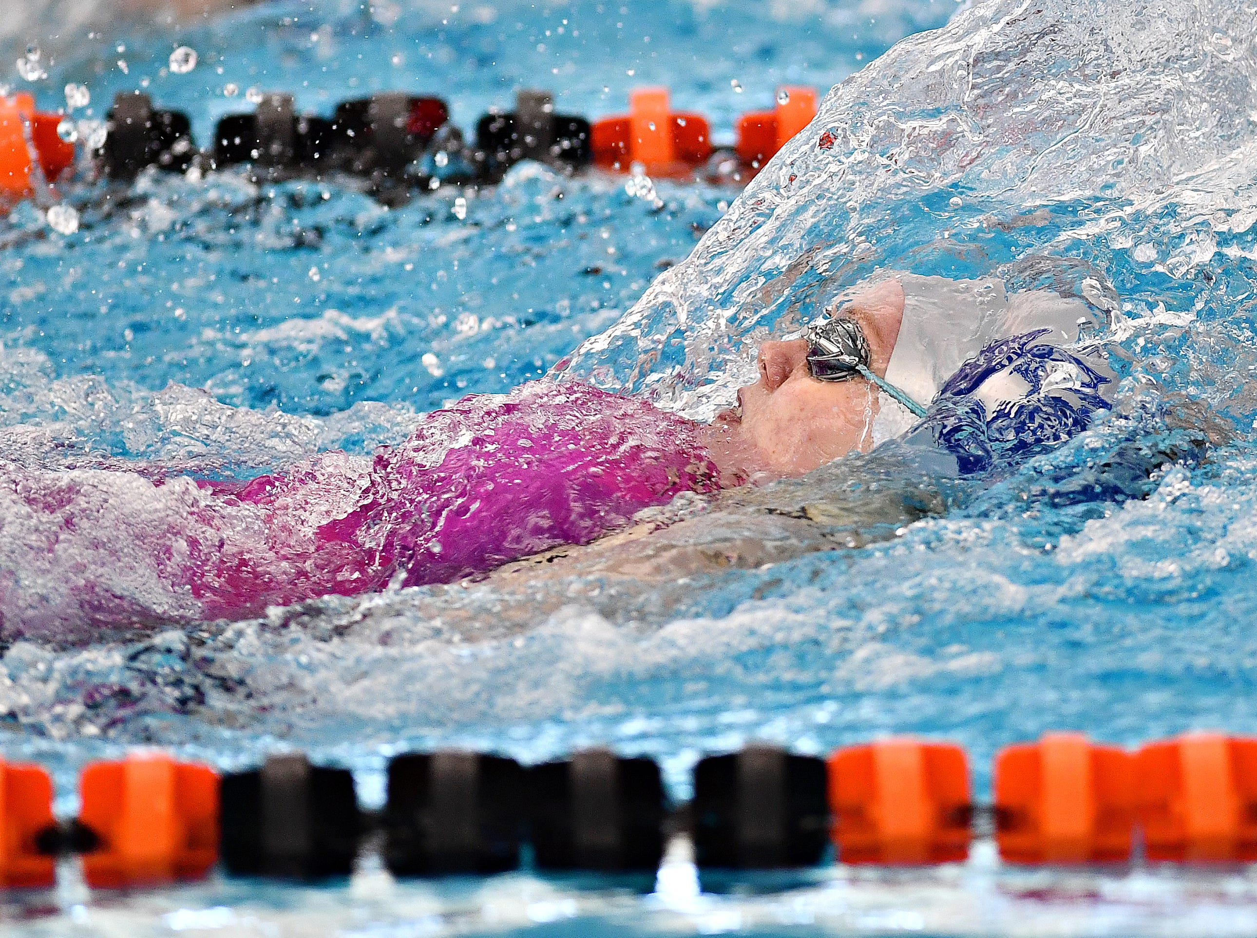 New Oxford's Ashley Myers competes in the 100 Yard Backstroke event during York-Adams League Swimming Championship at Central York High School in Springettsbury Township, Saturday, Feb. 9, 2019. Dawn J. Sagert photo