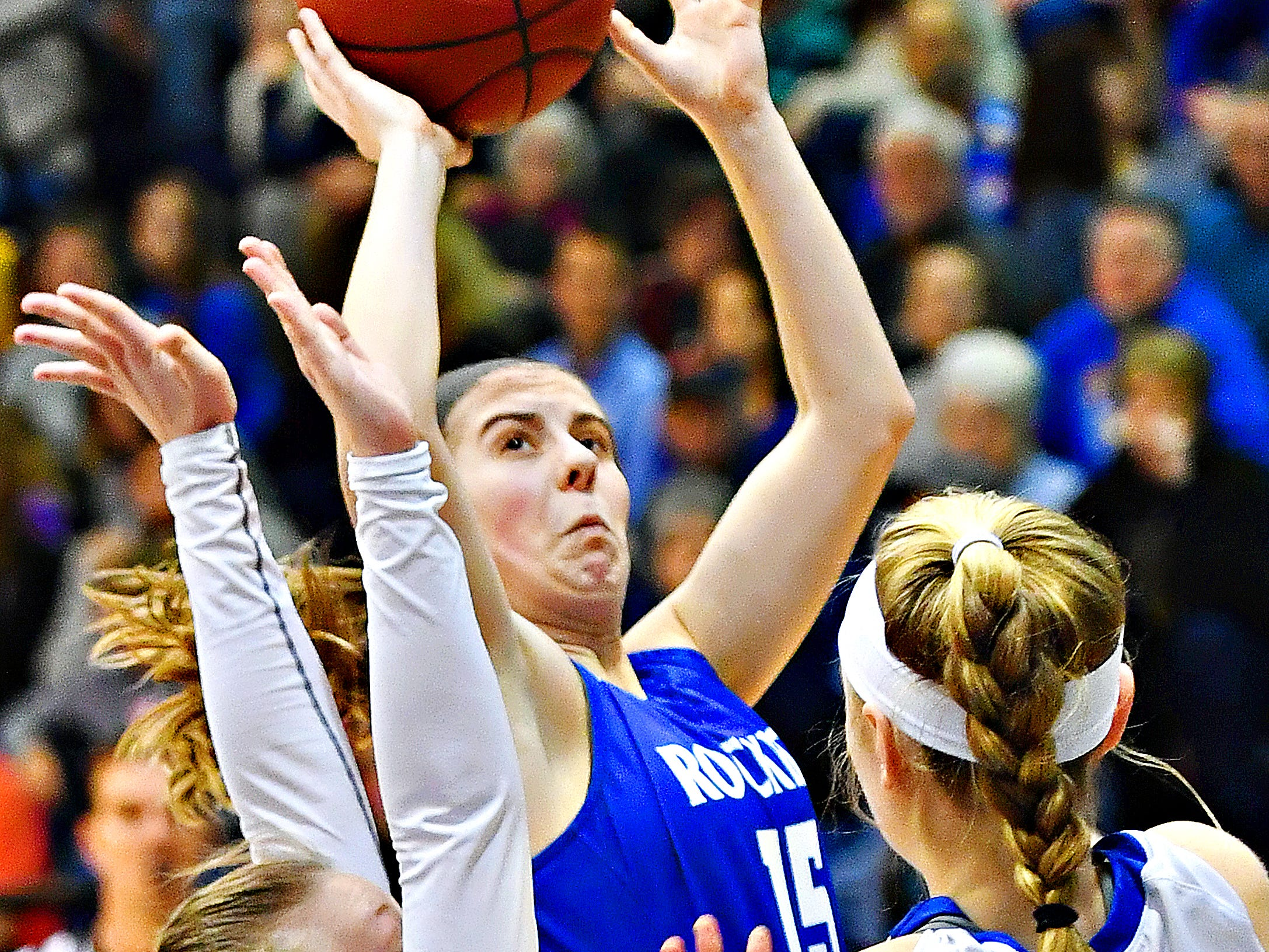Spring Grove's Lexi Hoffman, back, lines up her shot while Kennard-Dale defends during York-Adams League girls' basketball quarterfinal action at Dallastown Area High School in York Township, Friday, Feb. 8, 2019. Spring Grove would win the game 47-38. Dawn J. Sagert photo