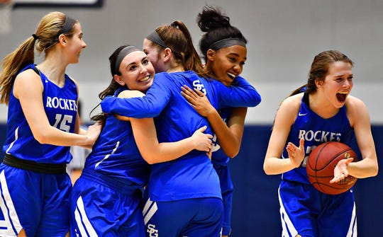 Spring Grove celebrates a 47-38 win over Kennard-Dale during York-Adams League girls' basketball quarterfinal action at Dallastown Area High School in York Township, Friday, Feb. 8, 2019. Dawn J. Sagert photo