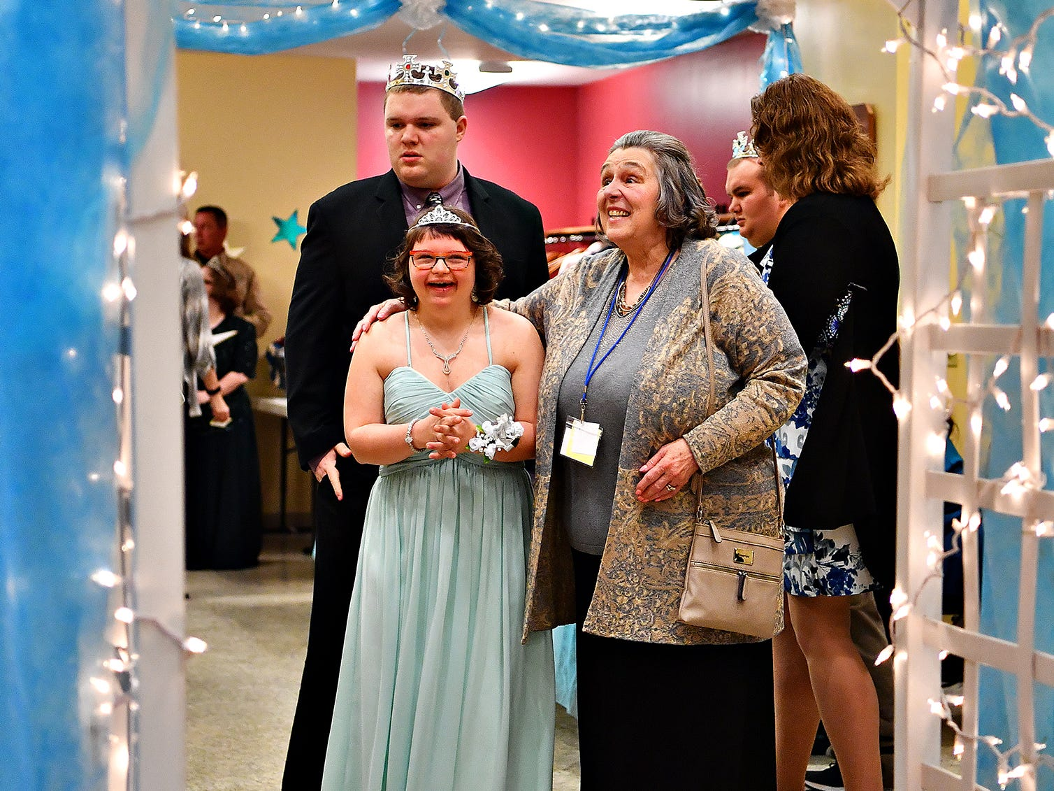 Casey Duncan, 17, left, of New Freedom, waits excitedly with her buddy for the night, Susan Mattern, of York City, as she prepares for make her red carpet entrance during A Night to Shine, a Tim Tebow Foundation sponsored prom for people with special needs, at Friendship Community Church in Dover Friday, Feb. 8, 2019. Dawn J. Sagert photo