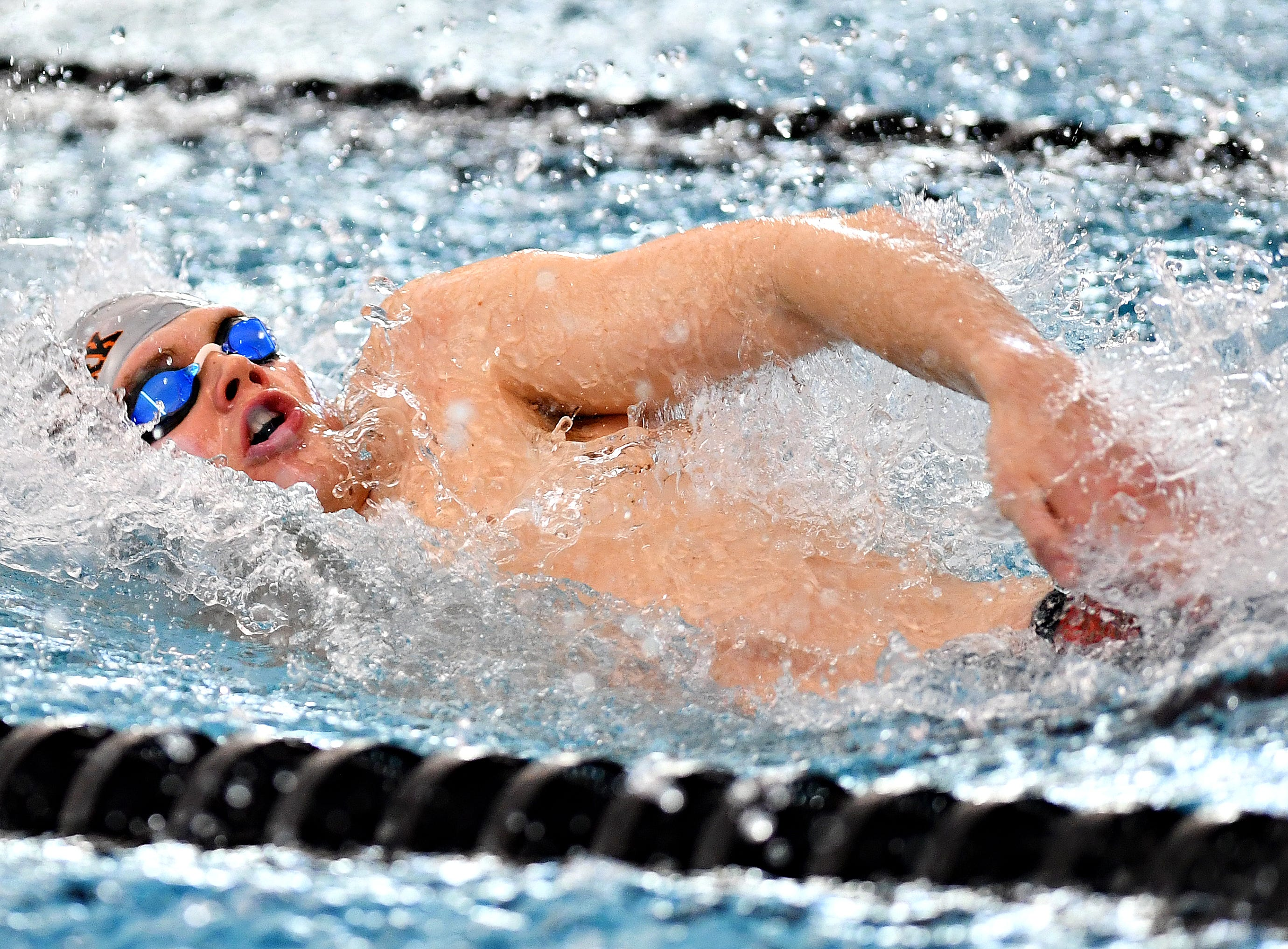 Central York's Jared Hicks competes in the 100 Yard Backstroke event during the York-Adams League Swimming Championship at Central York High School in Springettsbury Township, Saturday, Feb. 9, 2019. Dawn J. Sagert photo