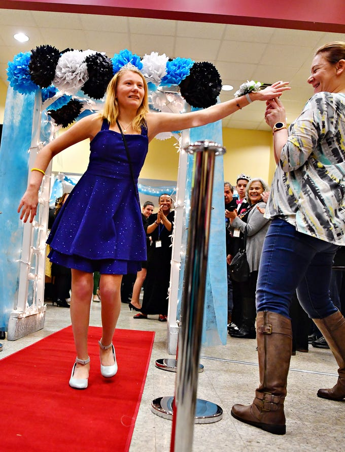 Hailey Cornbower, 15, left, discourages her mother Yes Cornbower, right, both of Wrightsville, from taking photos as she makes her grand entrance on the red carpet during A Night to Shine, a Tim Tebow Foundation sponsored prom for people with special needs, at Friendship Community Church in Dover Friday, Feb. 8, 2019. Frank attends Lennard-Dale High School. Dawn J. Sagert photo