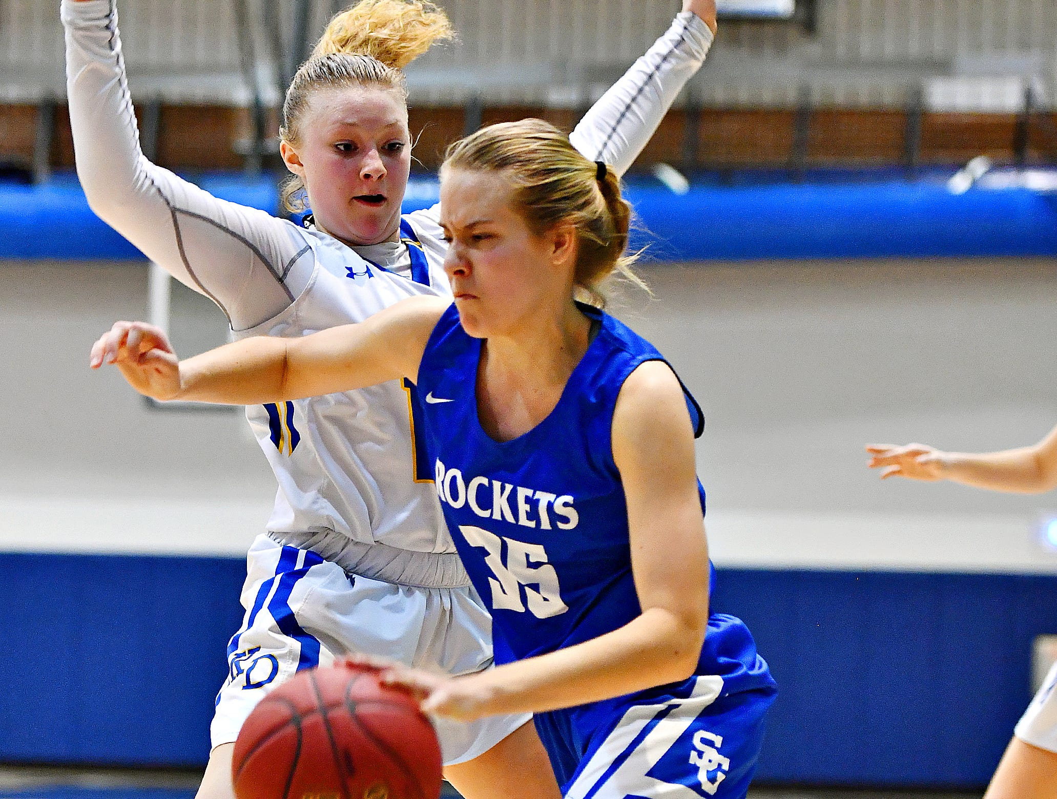 Spring Grove's Brooklyn Naylor, front, pushes to get past Kennard-Dale's Chandler Swanson during York-Adams League girls' basketball quarterfinal action at Dallastown Area High School in York Township, Friday, Feb. 8, 2019. Spring Grove would win the game 47-38. Dawn J. Sagert photo
