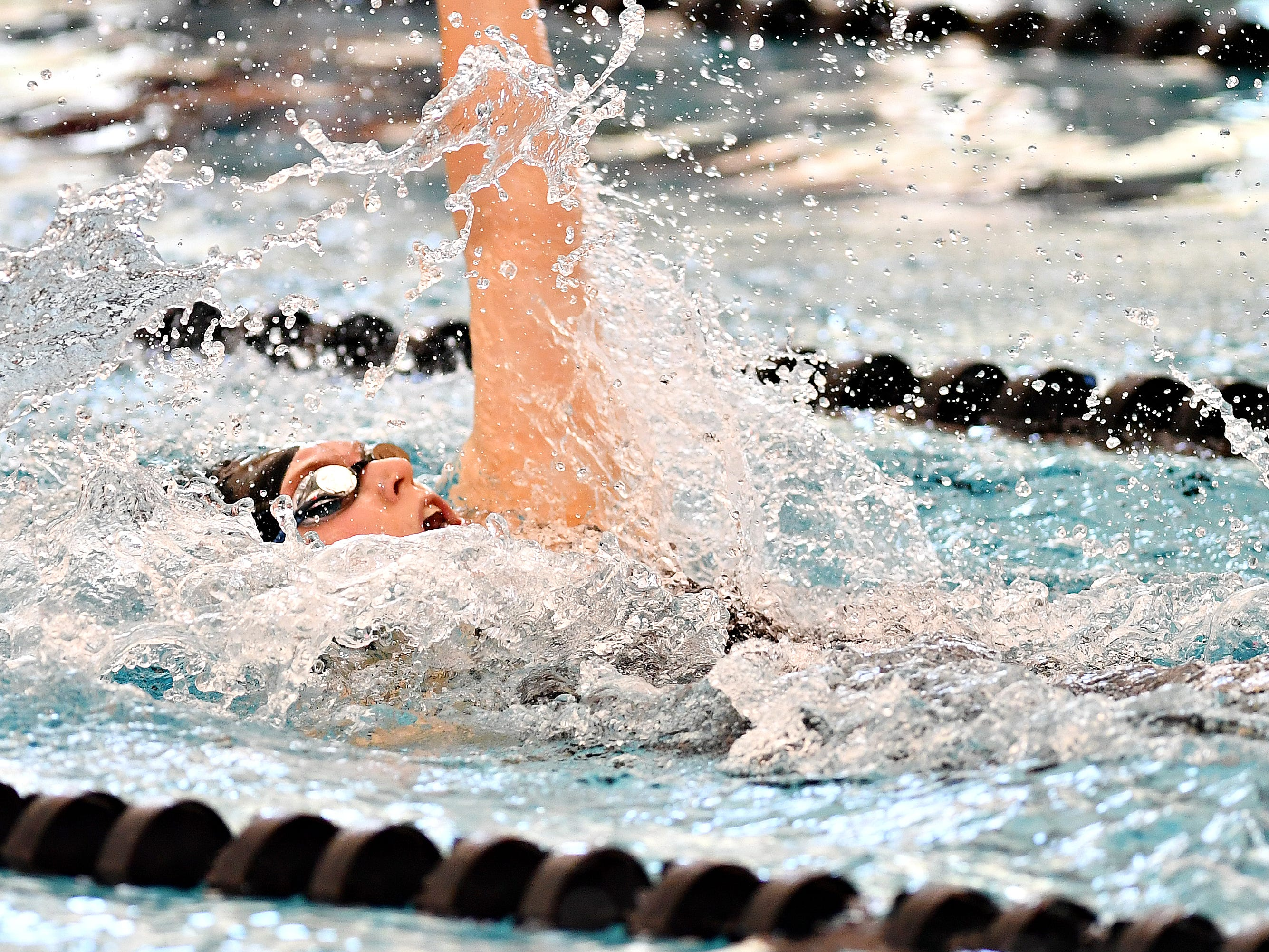 York Suburban's Maddy Abel competes in the 100 Yard Backstroke event during York-Adams League Swimming Championship at Central York High School in Springettsbury Township, Saturday, Feb. 9, 2019. Dawn J. Sagert photo