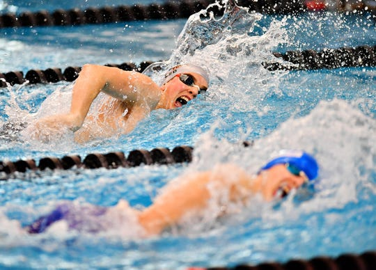 Central York's Cameron Speed, back, and Spring Grove's Daniel Gordon compete in the 400 Yard Freestyle Relay event during the York-Adams League Swimming Championship at Central York High School in Springettsbury Township, Saturday, Feb. 9, 2019. Dawn J. Sagert photo