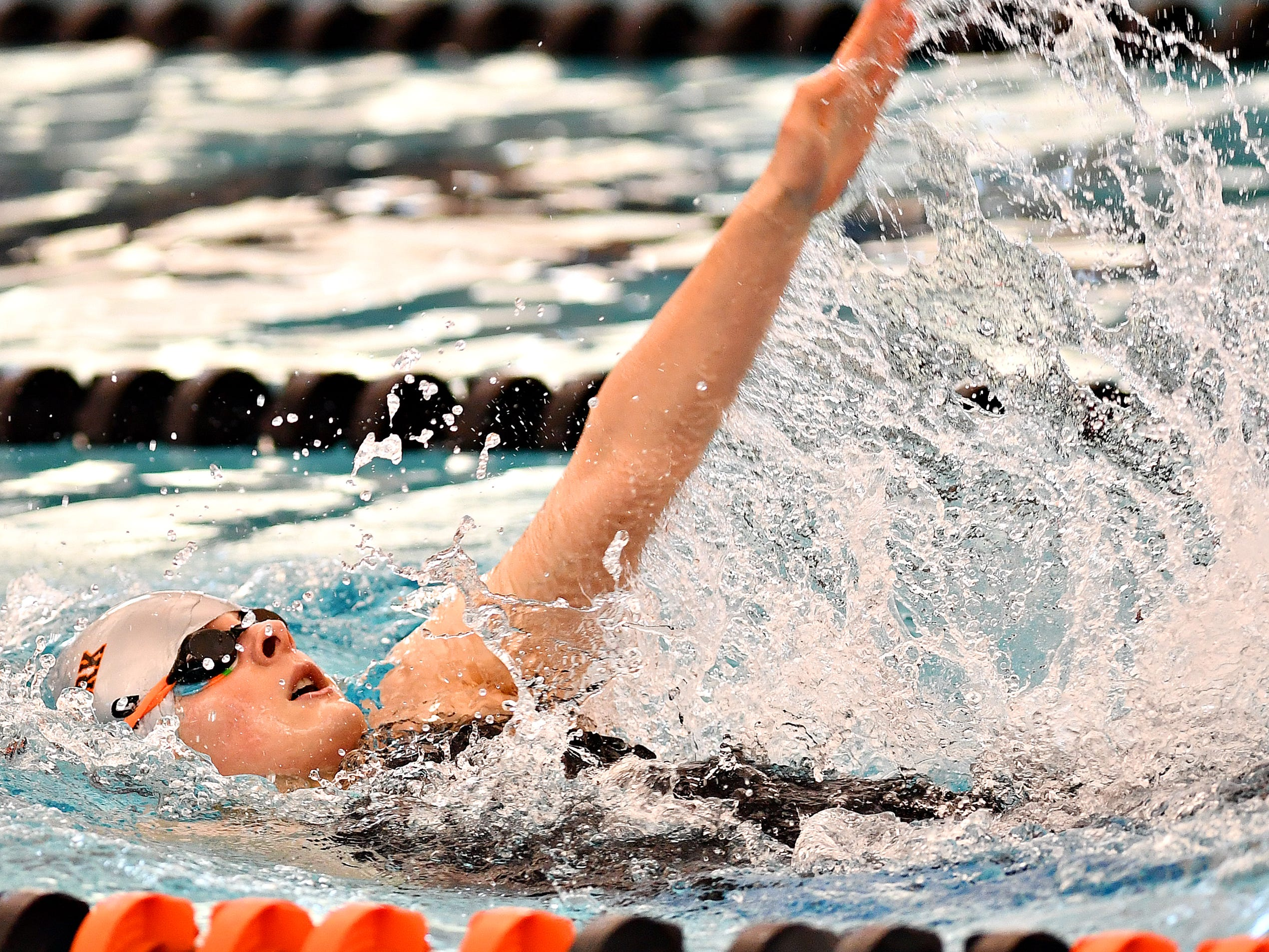 Central York's Camryn Leydig competes in the 100 Yard Backstroke event during the York-Adams League Swimming Championship at Central York High School in Springettsbury Township, Saturday, Feb. 9, 2019. Leydig would win the event at 56.67. Dawn J. Sagert photo