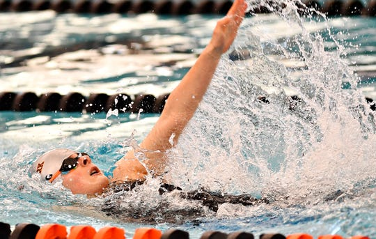 Central York's Camryn Leydig competes in, and wins, the 100 backstroke during the York-Adams League Swimming Championships at Central York High School in 2019. Leydig returns for the Panthers for the 2019-2020 season.