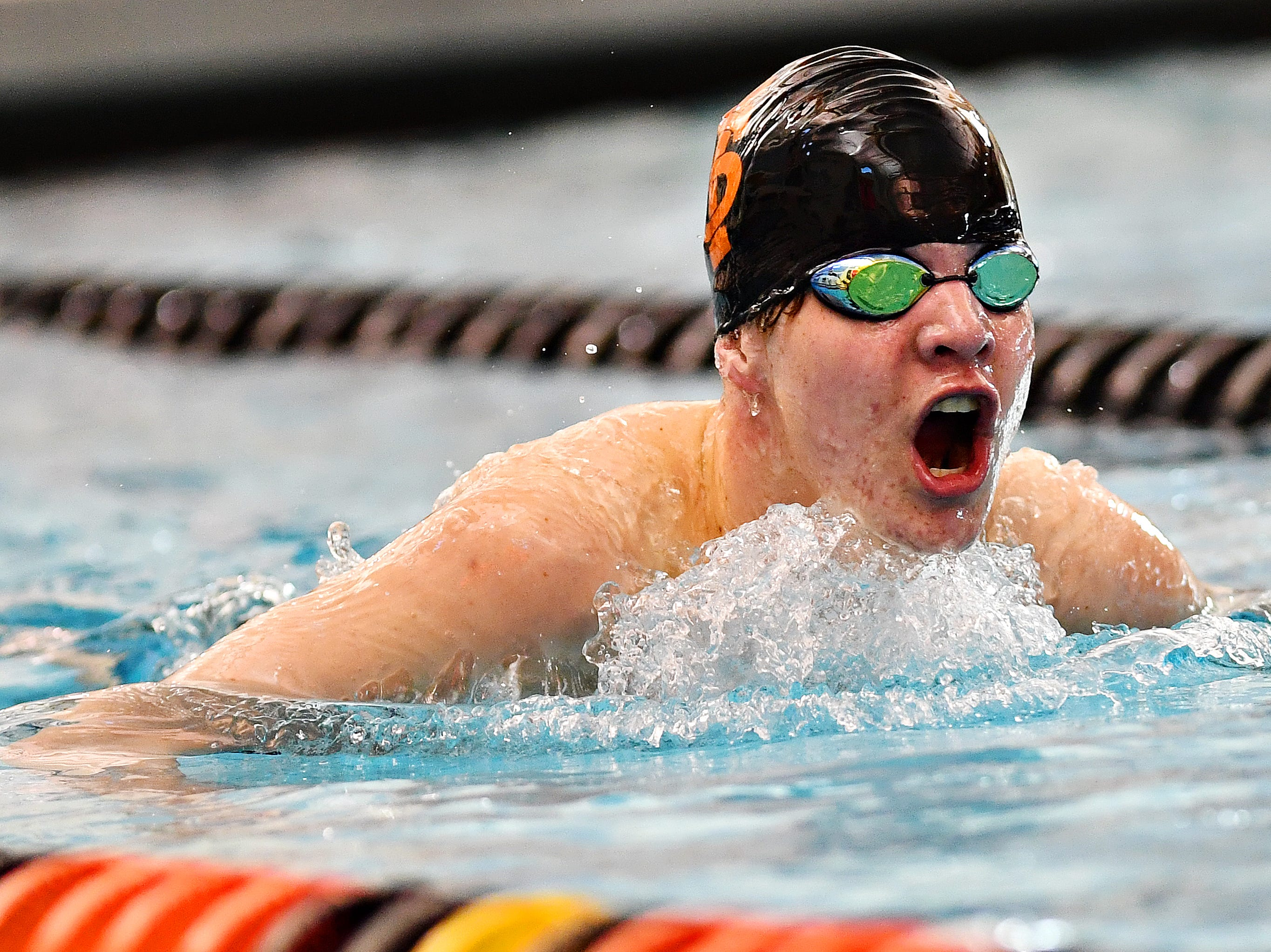 York Suburban's Tyler Herink competes in the 100 Yard Breaststroke event during the York-Adams League Swimming Championship at Central York High School in Springettsbury Township, Saturday, Feb. 9, 2019. Dawn J. Sagert photo