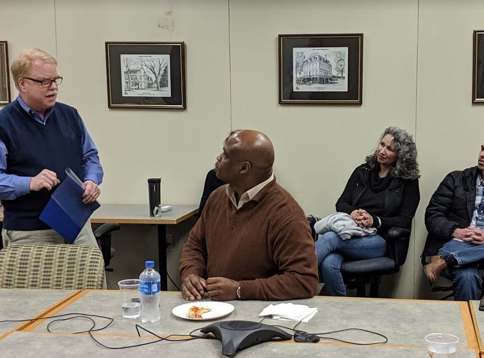 As he addresses the newsroom during his recent retirement announcement, YDR editor Jim McClure, left, talks of his newsroom's successes with Hollis Towns, Gannett's Northeast Region editor. Also attending, on right, were McClure's wife Della and son Joe.