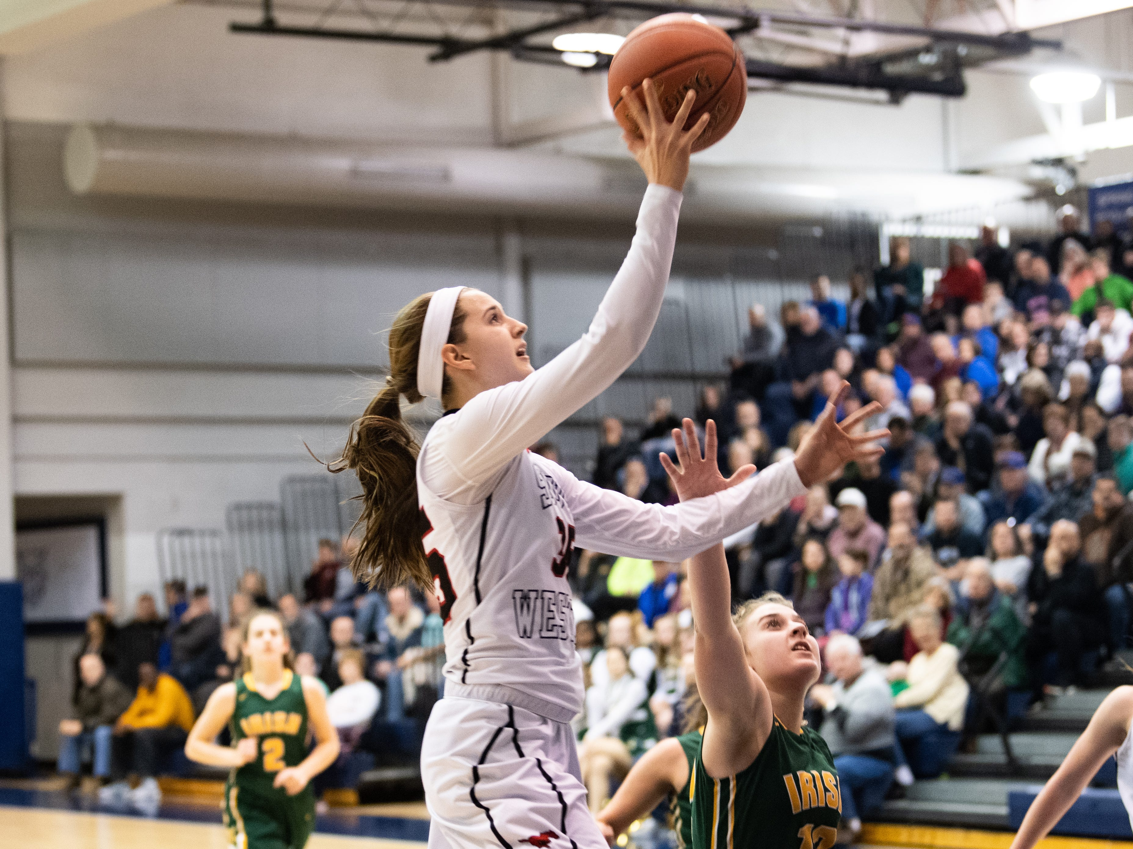 T. Geiman (35) of South Western takes the easy layup during the YAIAA girls' basketball quarterfinal game between South Western and York Catholic, February 8, 2019 at Dallastown Area High School. The Mustangs defeated the Fighting Irish at 53-20.