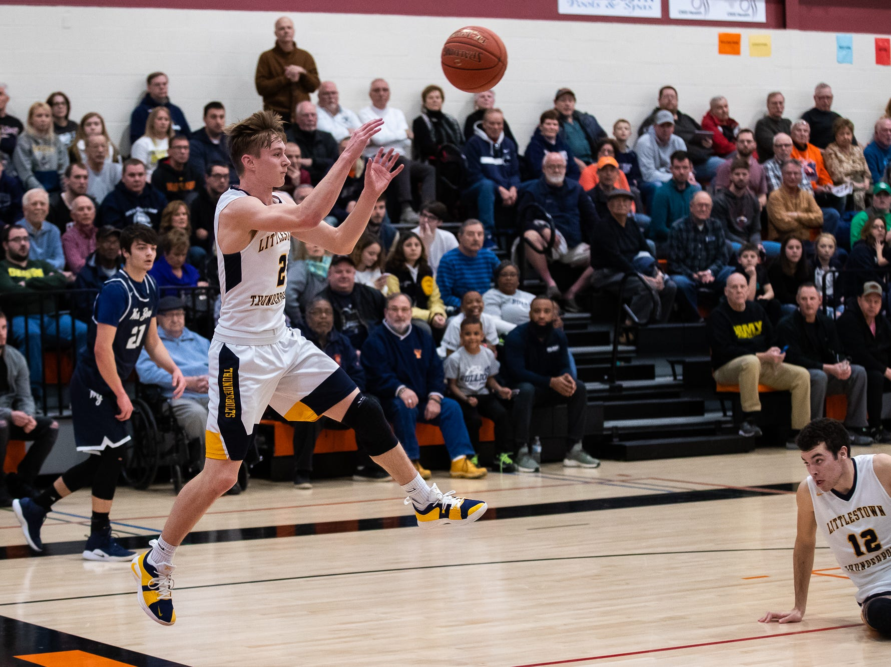 Littlestown's Jakob Lane (2) throws the ball back into play during the first half of the YAIAA boys' basketball quarterfinals between Littlestown and West York, Saturday, Feb. 9, 2019, at Central York High School. West York led Littlestown 33-31 at the half.