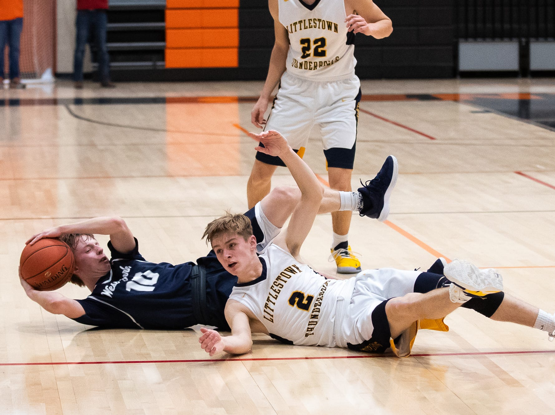 West York's Corey Wise (10) intercepts the ball from Littlestown's Jakob Lane (2) during the first half of the YAIAA boys' basketball quarterfinals between Littlestown and West York, Saturday, Feb. 9, 2019, at Central York High School. West York led Littlestown 33-31 at the half.