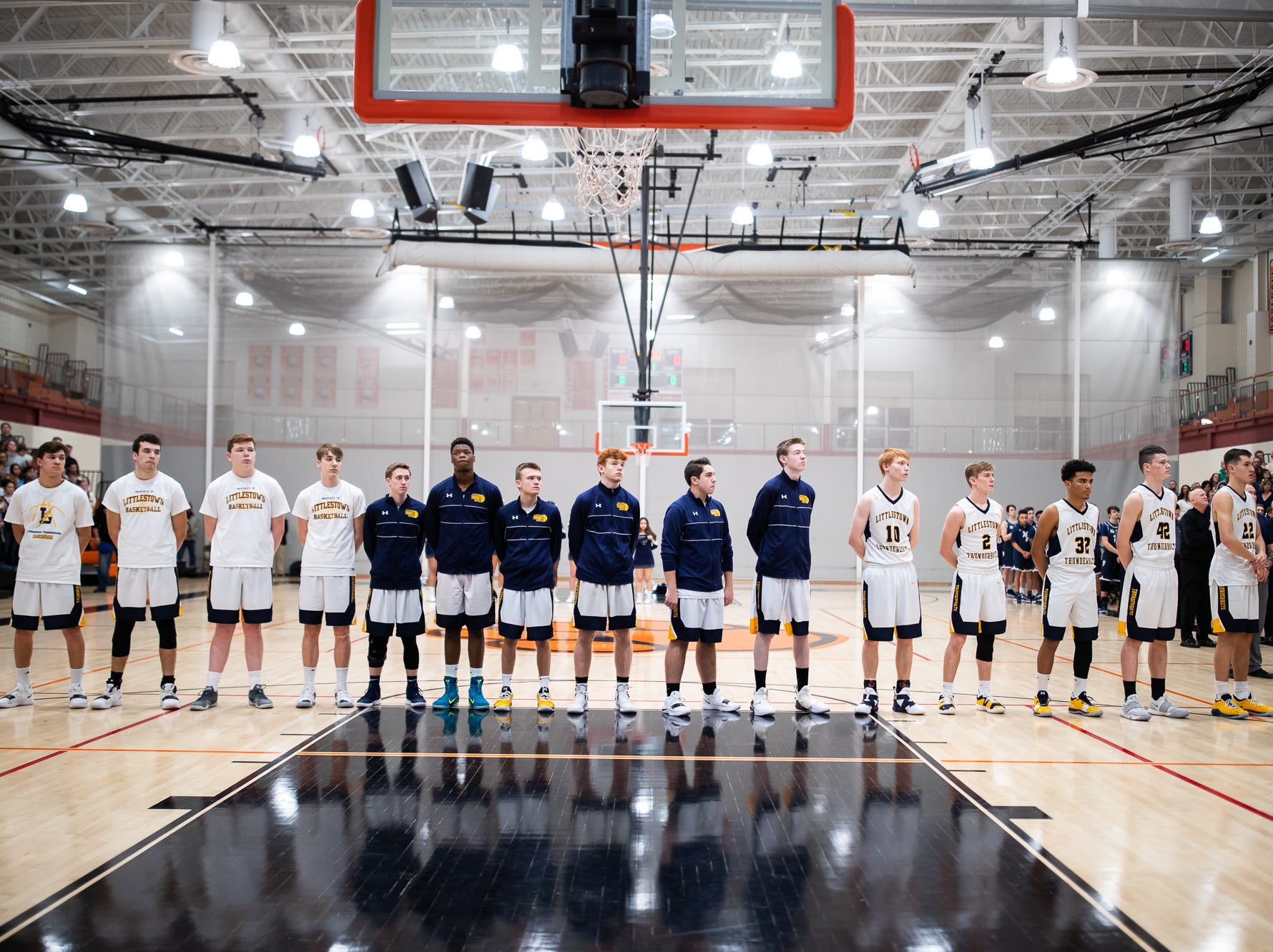 The Littlestown Bolts stand for the national anthem before the first half of the YAIAA boys' basketball quarterfinals between Littlestown and West York, Saturday, Feb. 9, 2019, at Central York High School. West York led Littlestown 33-31 at the half.