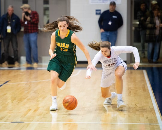 Dominica Martello of York Catholic and T. Geiman (35) of Southwestern go for the lose ball during the YAIAA girls' basketball quarterfinal game between South Western and York Catholic, February 8, 2019 at Dallastown Area High School. The Mustangs lead the Fighting Irish at halftime 24 to 10.