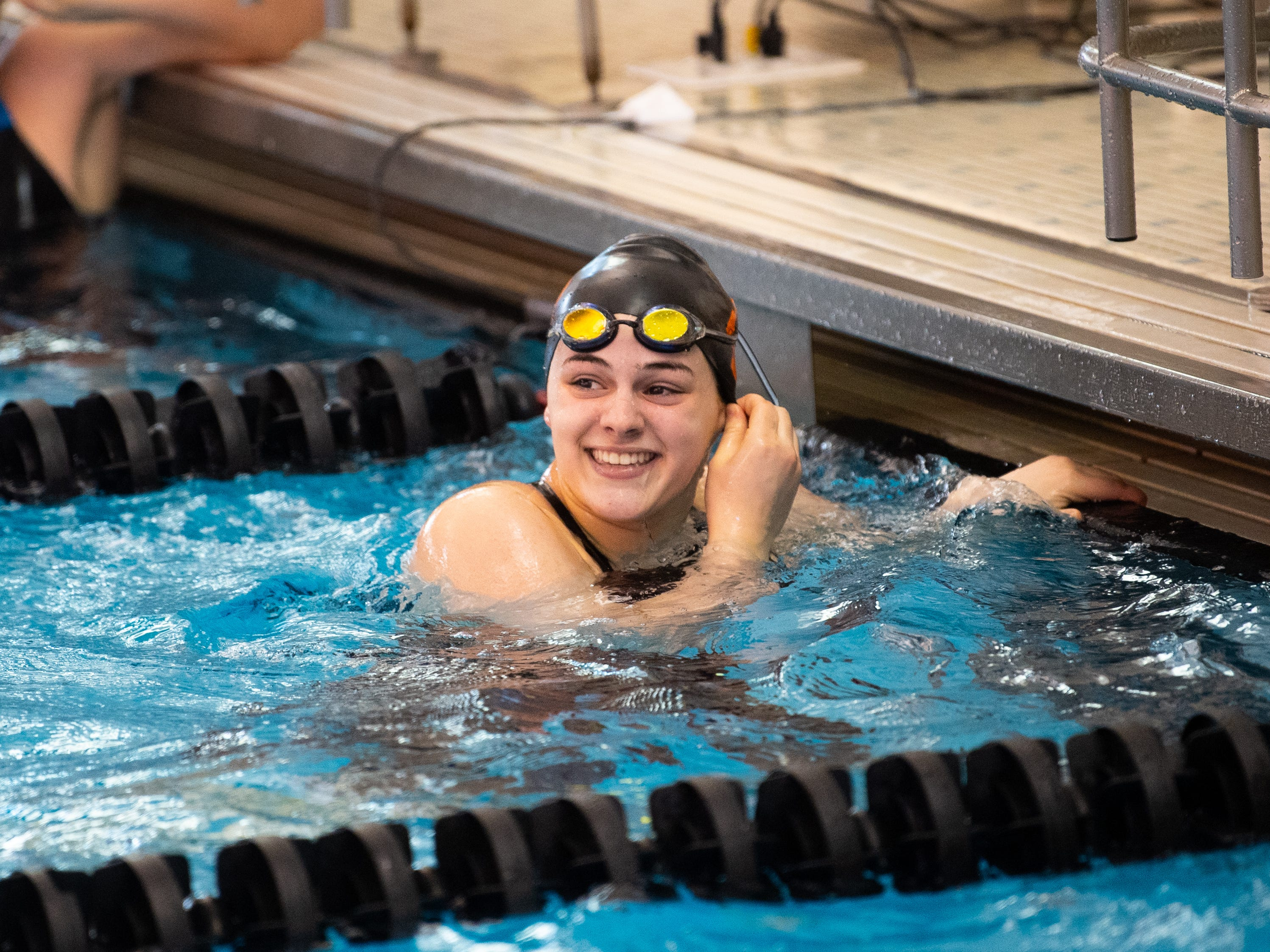 Sophia Guyer of York Suburban likes her time in the Girls 100 Yard Backstroke during the 2019 YAIAA Swimming and Diving Championships at Central York High School, February 9, 2019.