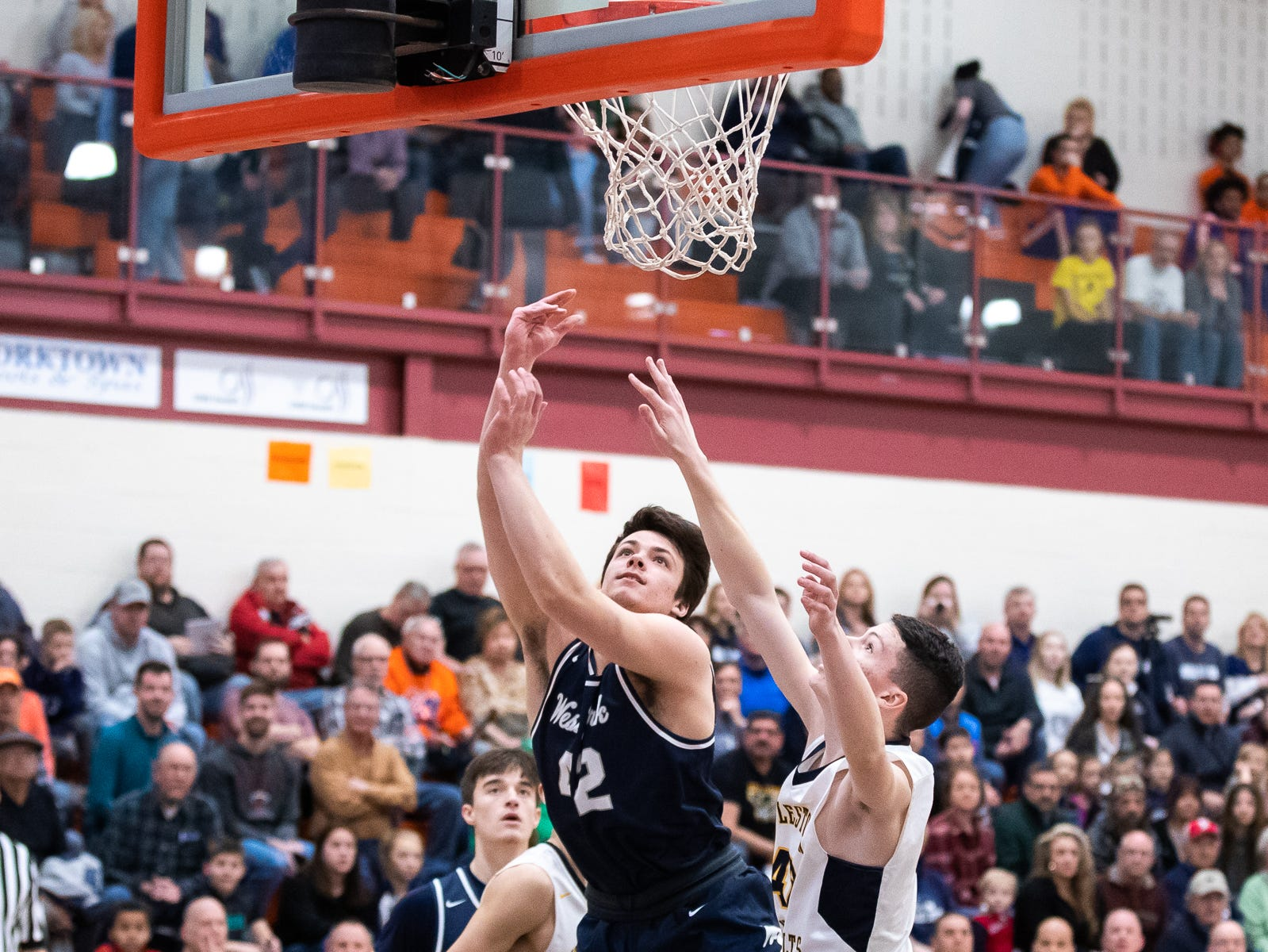 West York's Gabe Mummert (42) goes for a layup during the first half of the YAIAA boys' basketball quarterfinals between Littlestown and West York, Saturday, Feb. 9, 2019, at Central York High School. West York led Littlestown 33-31 at the half.