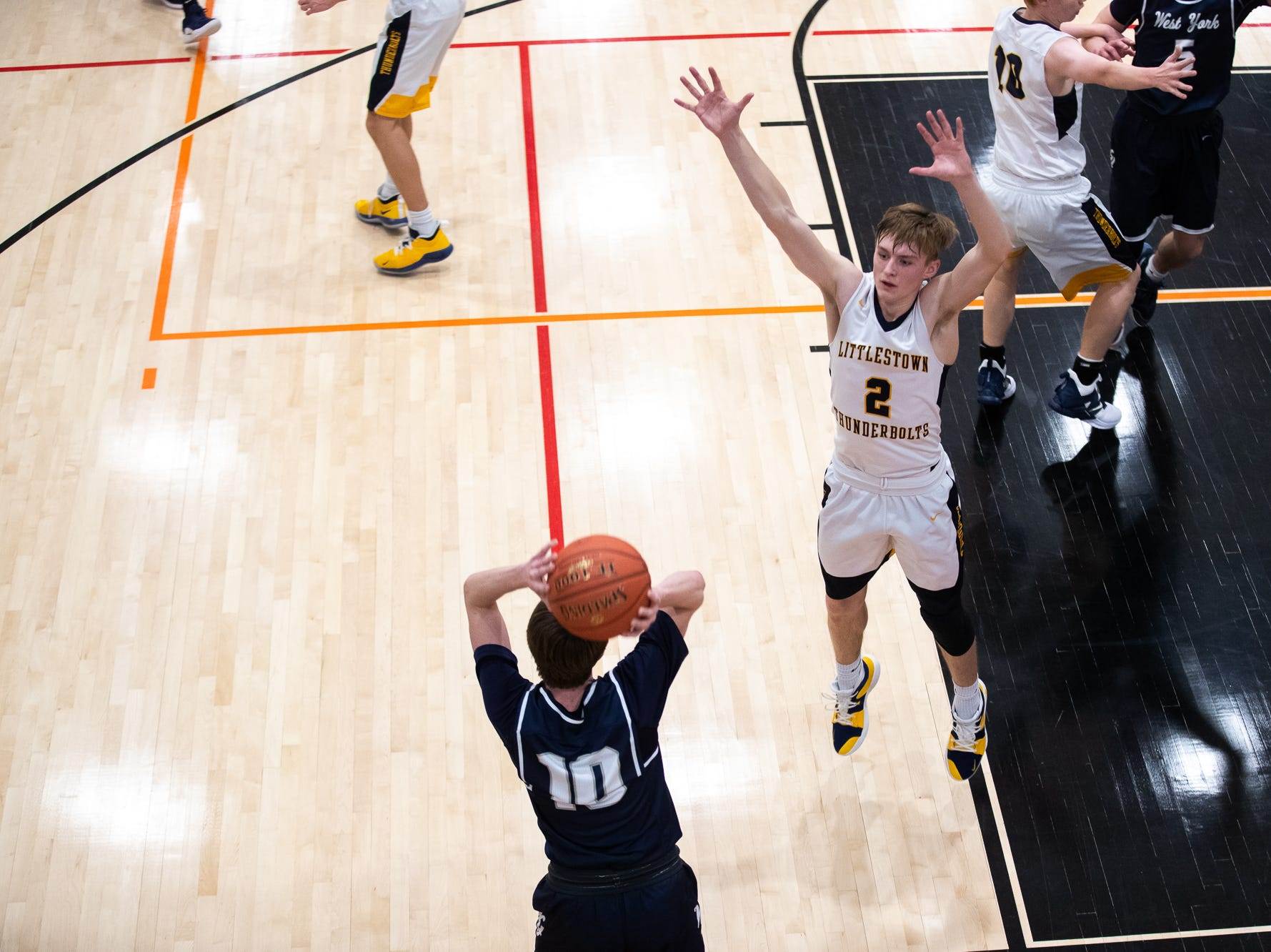 Littlestown's Jakob Lane (2) attempts to block a throw-in by West York's Corey Wise (10) during the first half of the YAIAA boys' basketball quarterfinals between Littlestown and West York, Saturday, Feb. 9, 2019, at Central York High School. West York led Littlestown 33-31 at the half.