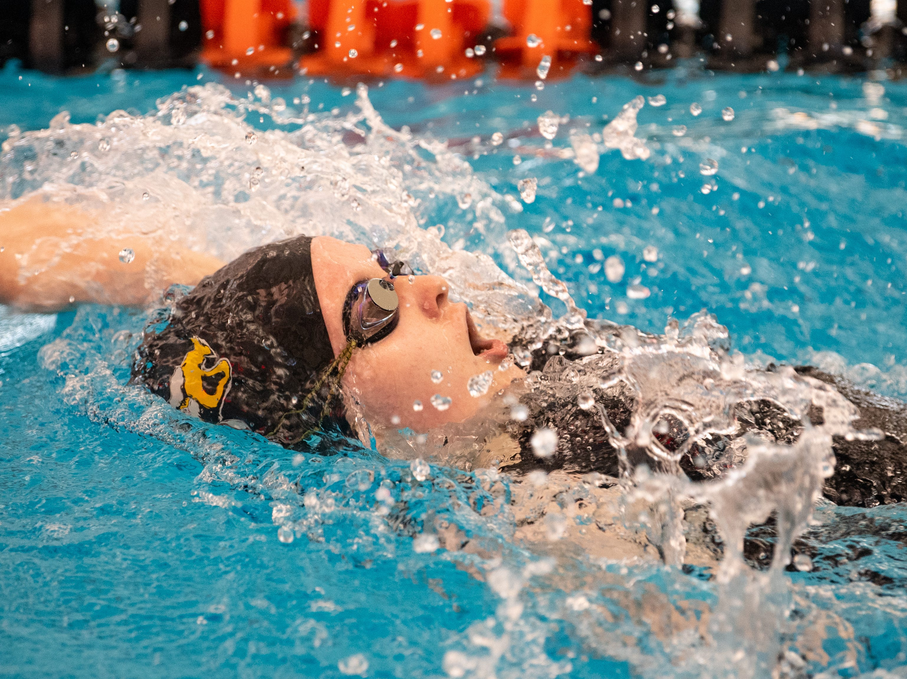 Madelynn Kinnard of Dover competes in the Girls 100 Yard Backstroke during the 2019 YAIAA Swimming and Diving Championships at Central York High School, February 9, 2019.