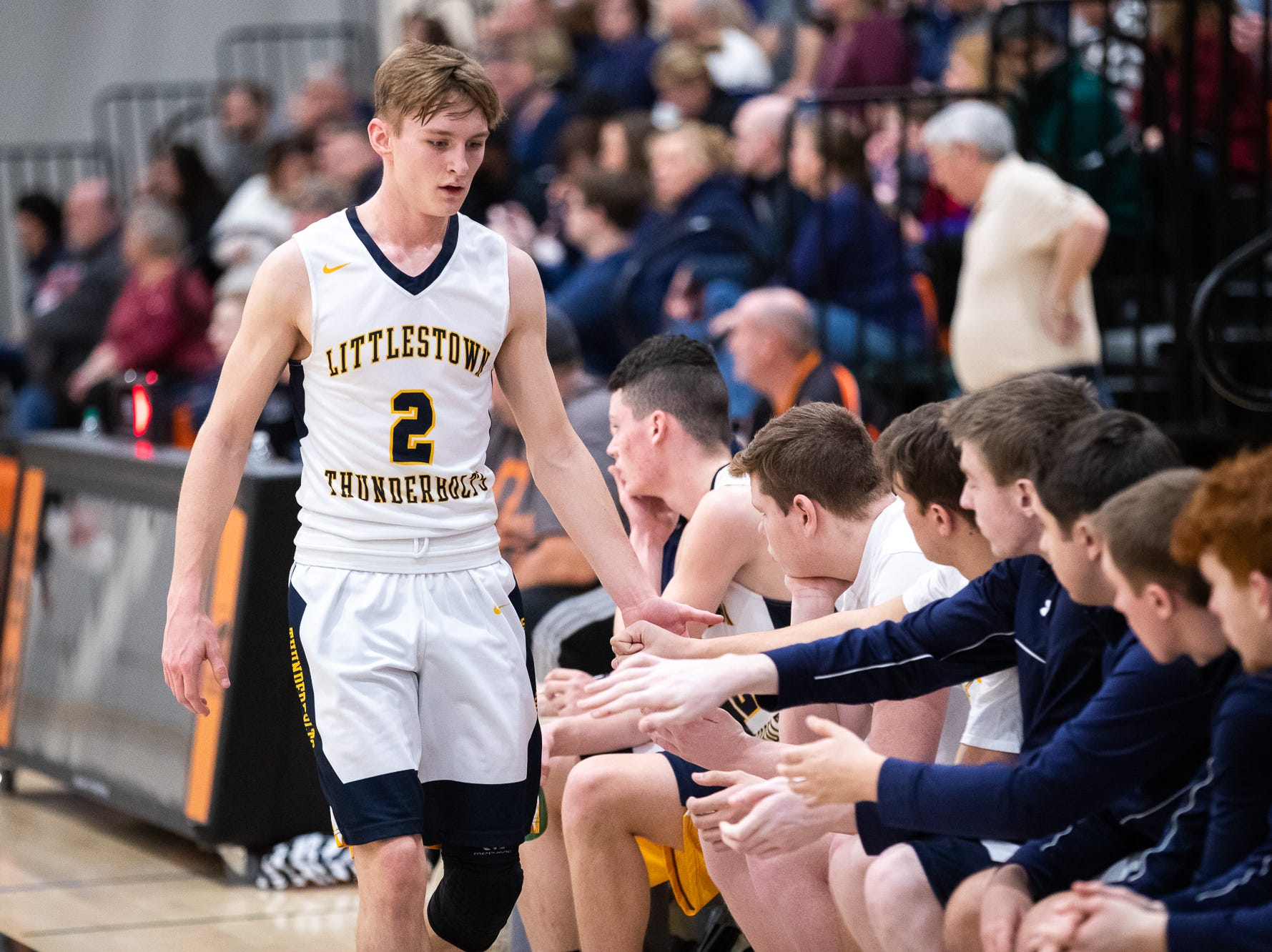 Littlestown's Jakob Lane (2) shakes hands with teammates while coming off the field during the first half of the YAIAA boys' basketball quarterfinals between Littlestown and West York, Saturday, Feb. 9, 2019, at Central York High School. West York led Littlestown 33-31 at the half.