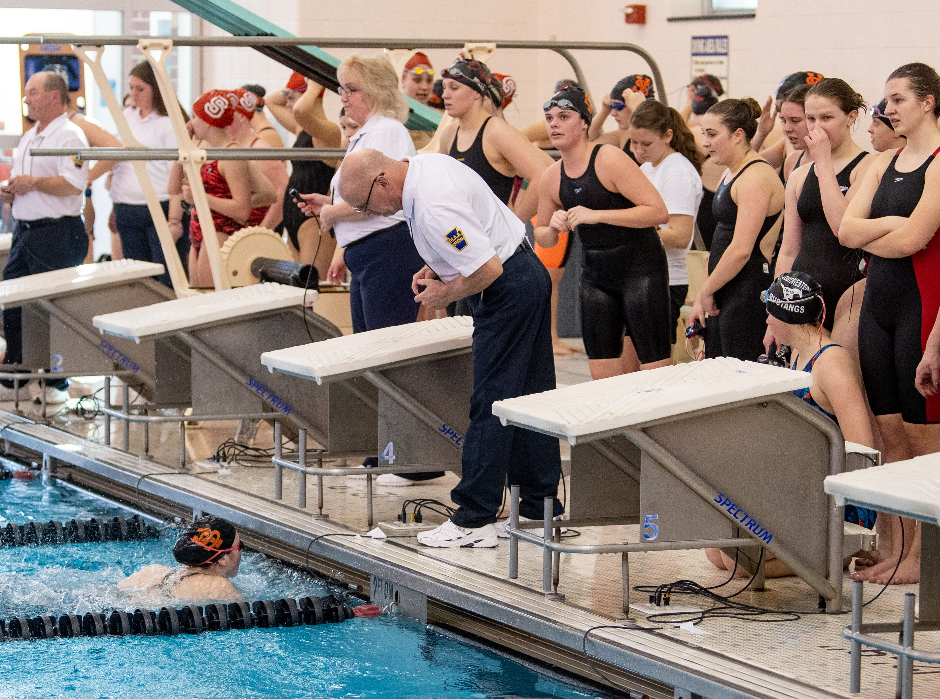 Judges make sure competitors touch the wall in the Girls 400 Yard Freestyle Relay during the 2019 YAIAA Swimming and Diving Championships at Central York High School, February 9, 2019.