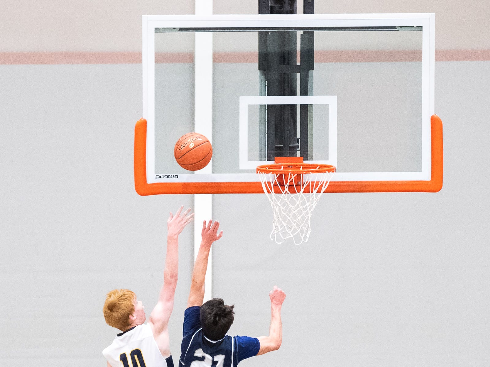 Littlestown's Daniel Gazmen (10) shoots while being guarded by West York's Jared Shearer (21) during the first half of the YAIAA boys' basketball quarterfinals between Littlestown and West York, Saturday, Feb. 9, 2019, at Central York High School. West York led Littlestown 33-31 at the half.