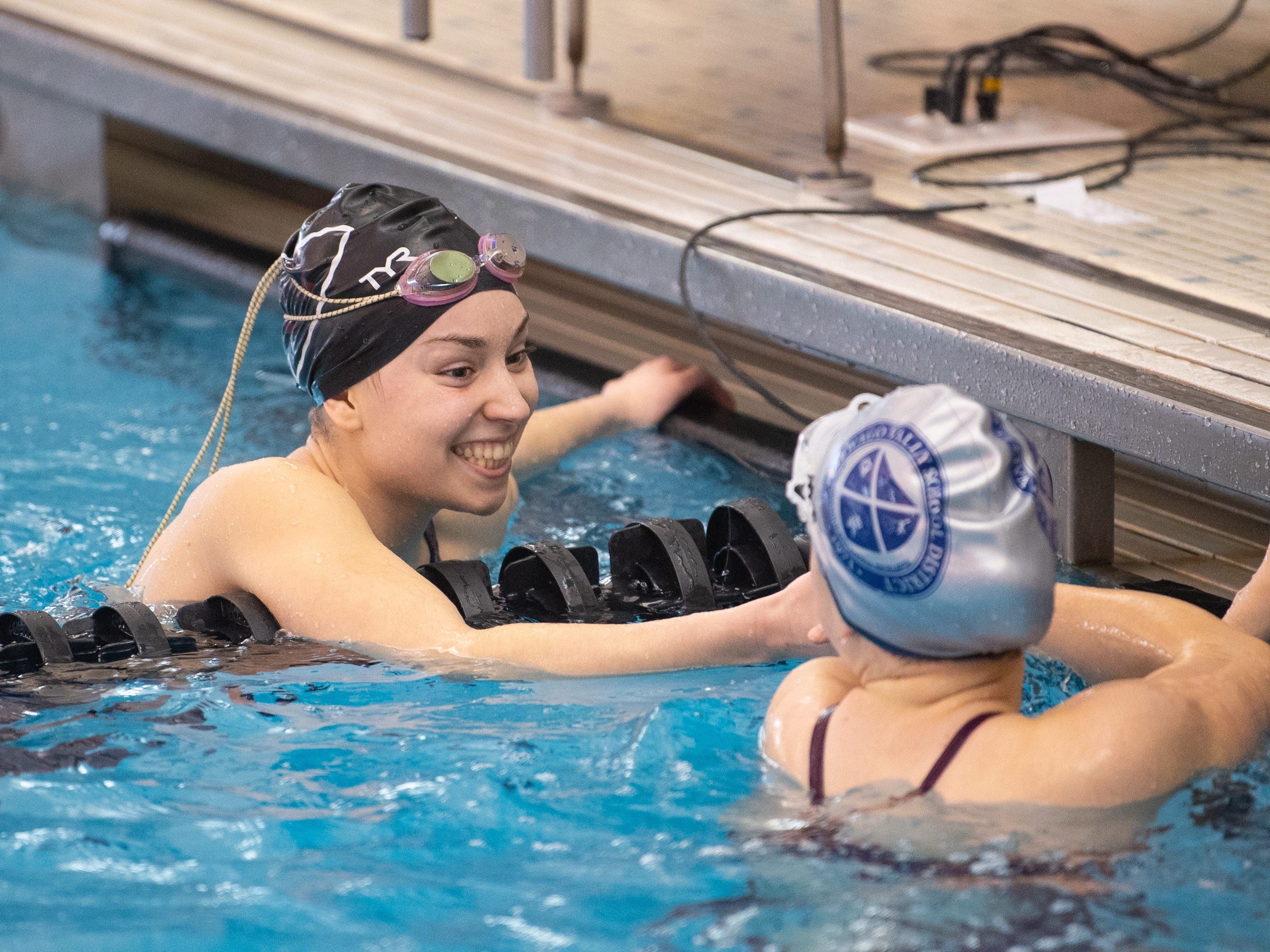 Gettysburg's Morgan Newell and New Oxford's Courtney Smith thank each other for a good race at the 2019 YAIAA Swimming and Diving Championships at Central York High School, February 9, 2019.