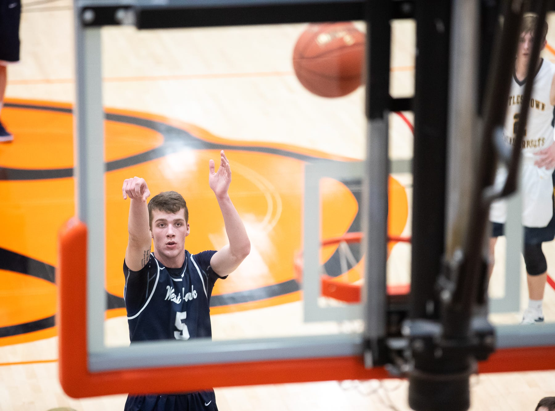 West York's Andrew LaManna (5) shoots a free throw during the first half of the YAIAA boys' basketball quarterfinals between Littlestown and West York, Saturday, Feb. 9, 2019, at Central York High School. West York led Littlestown 33-31 at the half.