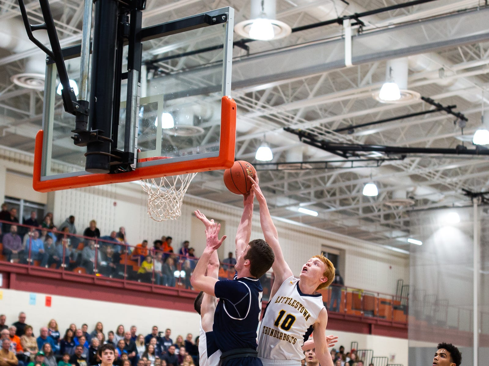 Littlestown's Daniel Gazmen (10) blocks West York's Andrew LaManna (5) as he goes for a layup during the first half of the YAIAA boys' basketball quarterfinals between Littlestown and West York, Saturday, Feb. 9, 2019, at Central York High School. West York led Littlestown 33-31 at the half.