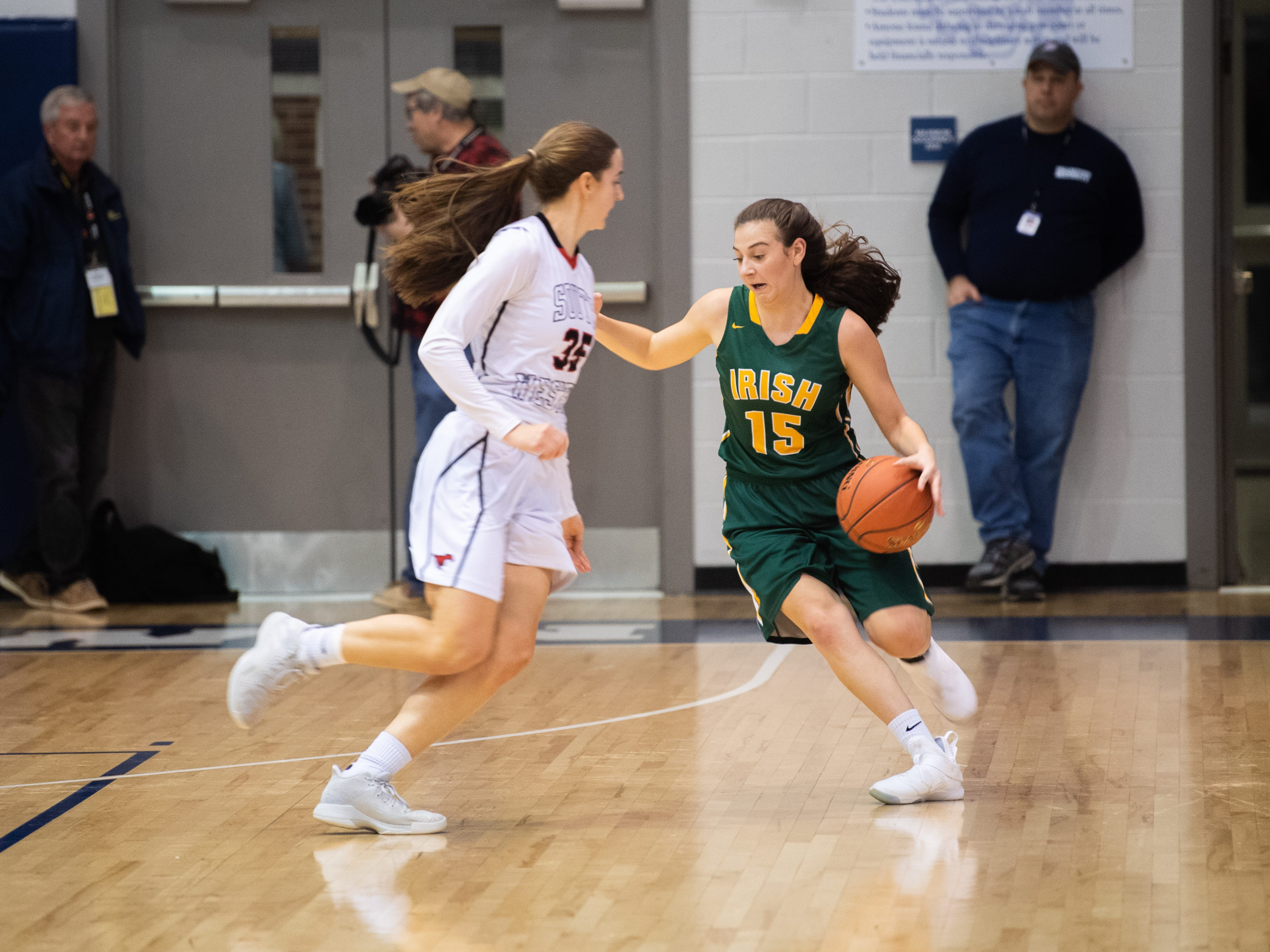 Dominica Martello (15) of York Catholic tries to beat the defense during the YAIAA girls' basketball quarterfinal game between South Western and York Catholic, February 8, 2019 at Dallastown Area High School. The Mustangs defeated the Fighting Irish at 53-20.