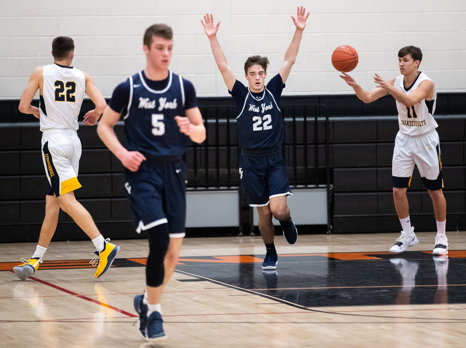 West York's Alex McClellan (22) throws his hands in the air after scoring during the first half of the YAIAA boys' basketball quarterfinals between Littlestown and West York, Saturday, Feb. 9, 2019, at Central York High School. West York led Littlestown 33-31 at the half.