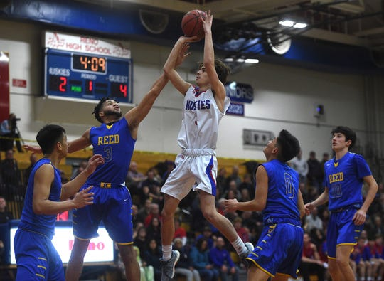 Reno's Nick Gonzalez (3) shoots while taking on Reed during their basketball game in Reno on Feb. 8, 2019.