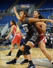 Nevada's Terae Briggs is covered by UNLV's Paris Strawther as she looks to get the pass in Wednesday's game at Lawor Events Center on Jan. 30, 2019. Nevada beat UNLV 62-70.