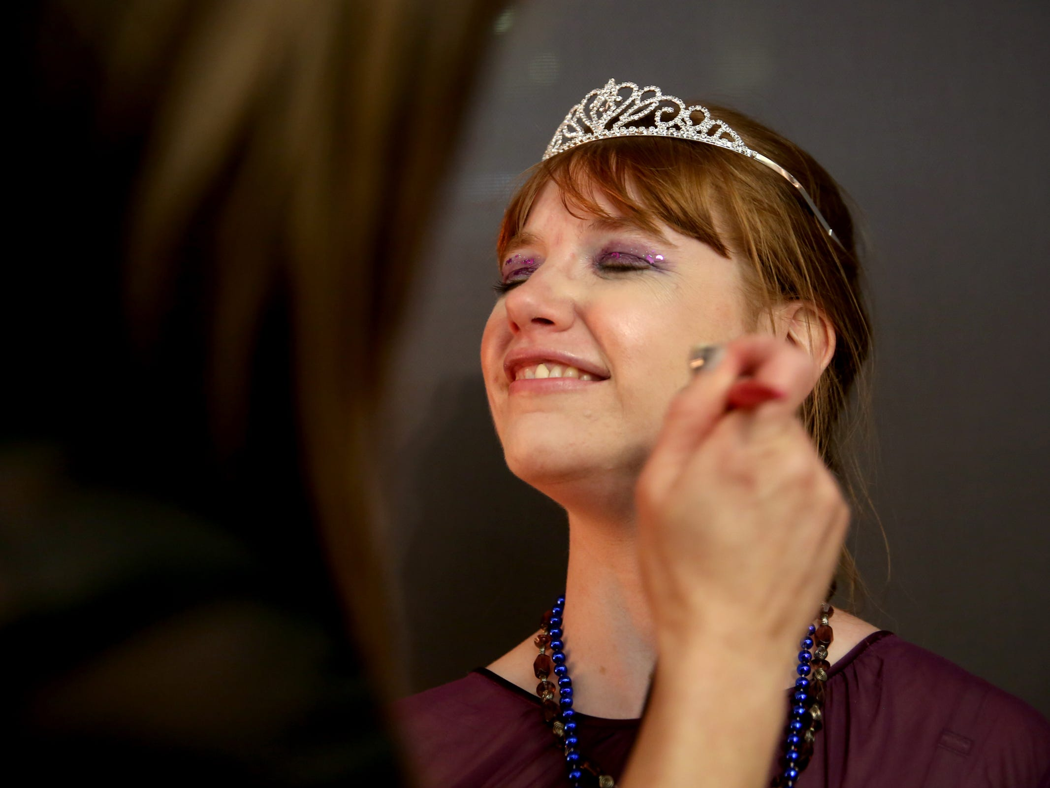 Kris Burden, 36, of Salem, has her airbrush makeup done by volunteer Kathy Tope at Night to Shine, a prom night experience for people with special needs, at Salem Alliance Church on Friday, Feb. 8, 2019.