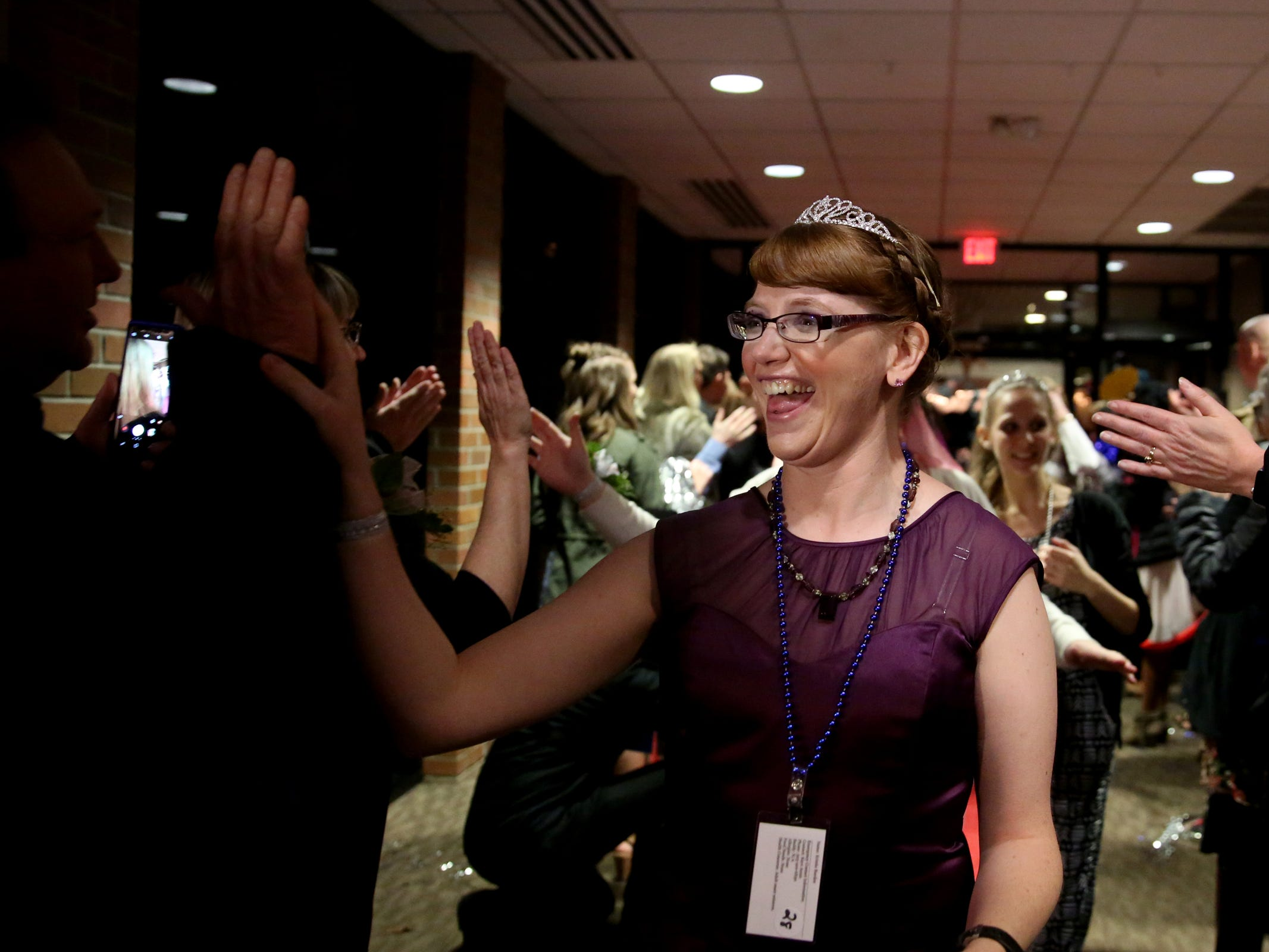 Kris Burden, 36, of Salem, walks the red carpet at Night to Shine, a prom night experience for people with special needs, at Salem Alliance Church on Friday, Feb. 8, 2019.