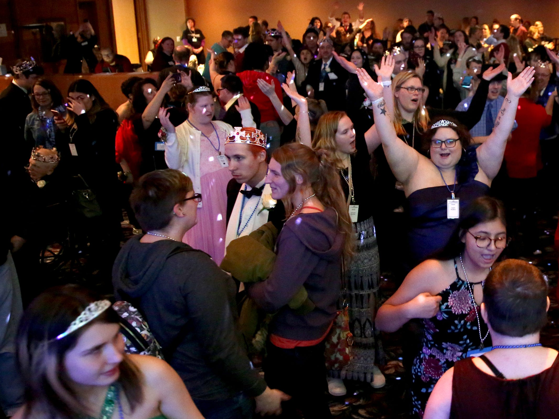 People dance at Night to Shine, a prom night experience for people with special needs, at Salem Alliance Church on Friday, Feb. 8, 2019.