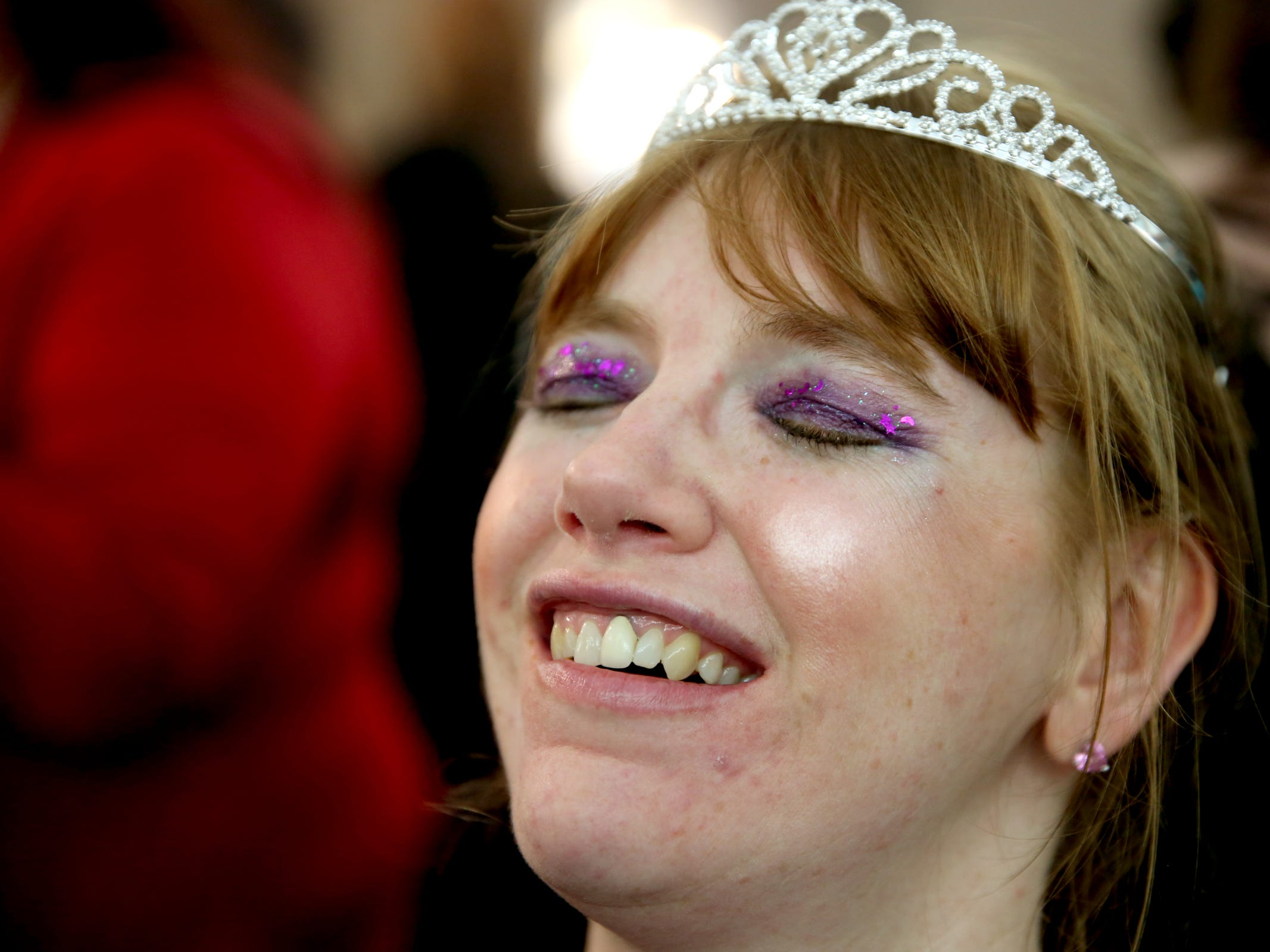 Kris Burden, 36, of Salem, has her makeup done by a volunteer at Night to Shine, a prom night experience for people with special needs, at Salem Alliance Church on Friday, Feb. 8, 2019.