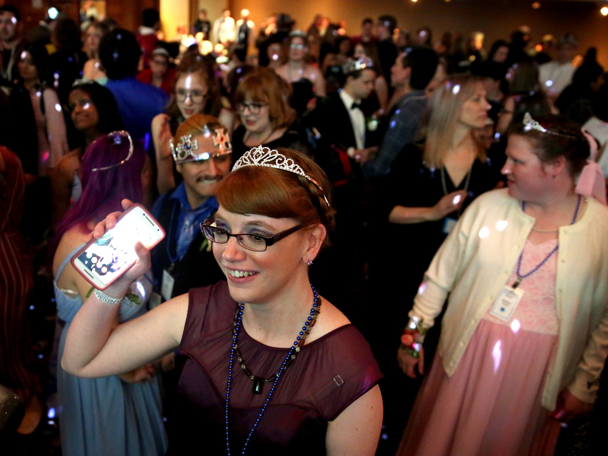 Kris Burden, 36, of Salem, dances at Night to Shine, a prom night experience for people with special needs, at Salem Alliance Church on Friday, Feb. 8, 2019.