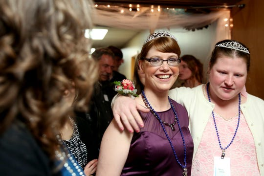 Kris Burden, left, 36, of Salem, and her friend Bethany Davis, 34, of Alliance, arrive at Night to Shine, a prom night experience for people with special needs, at Salem Alliance Church on Friday, Feb. 8, 2019.
