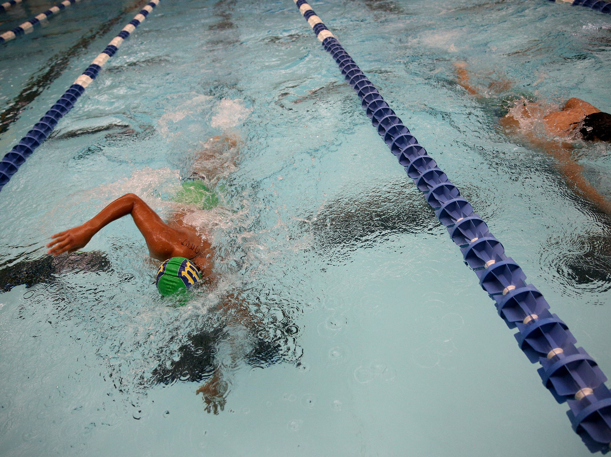 McKay junior Donovan Vega and West Salem sophomore Miguel Casas compete in the boys 500-yard freestyle at the OSAA 6A Mountain Valley Conference swimming championships at the Kroc Center in Salem, Oregon on Friday, Feb. 8, 2019.