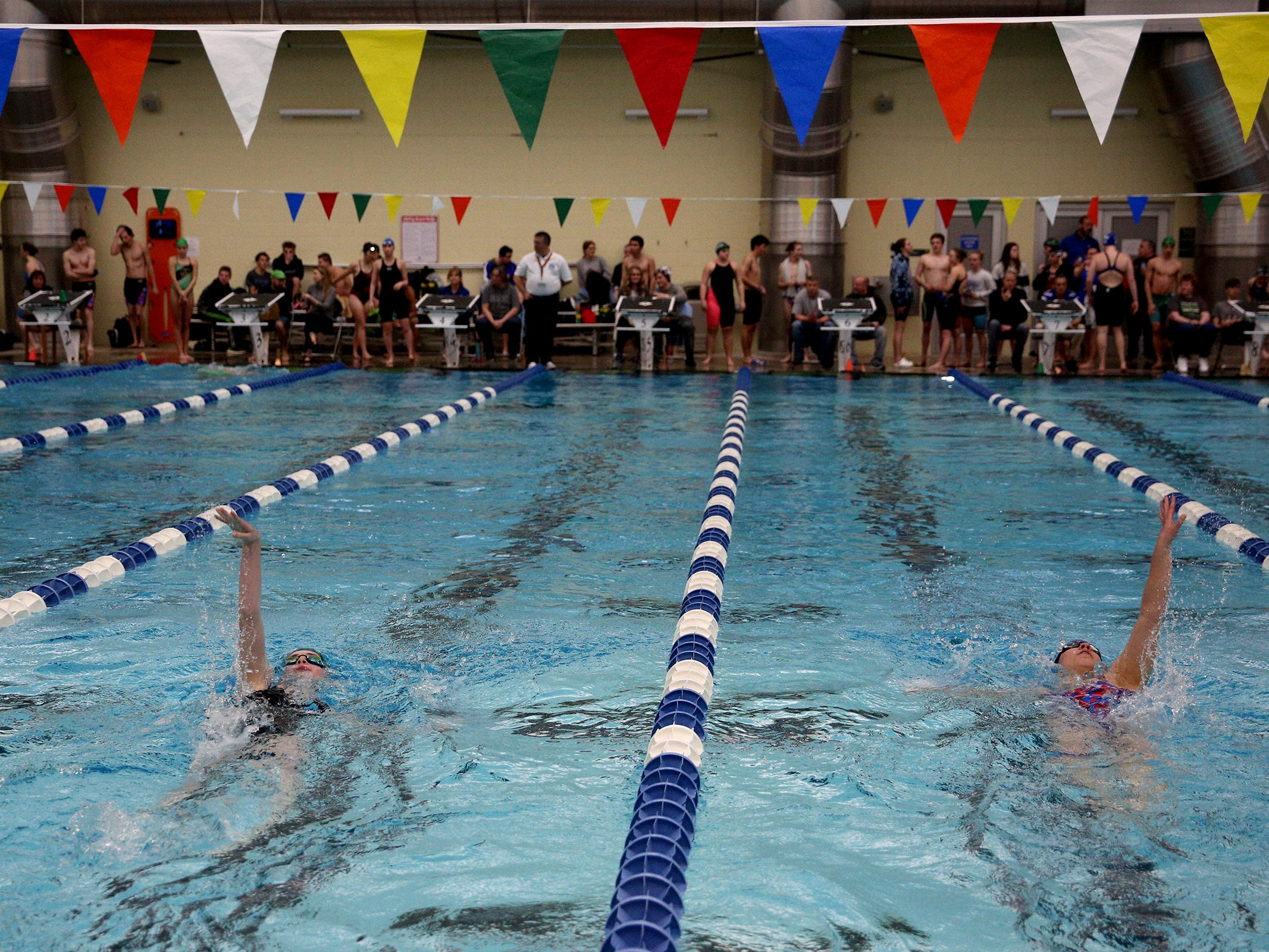West Salem sophomore Katelyn Hack (left) and South Salem senior Shelby Wasterberg (right) compete in the girls 200-yard IM at the OSAA 6A Mountain Valley Conference swimming championships at the Kroc Center in Salem, Oregon on Friday, Feb. 8, 2019.