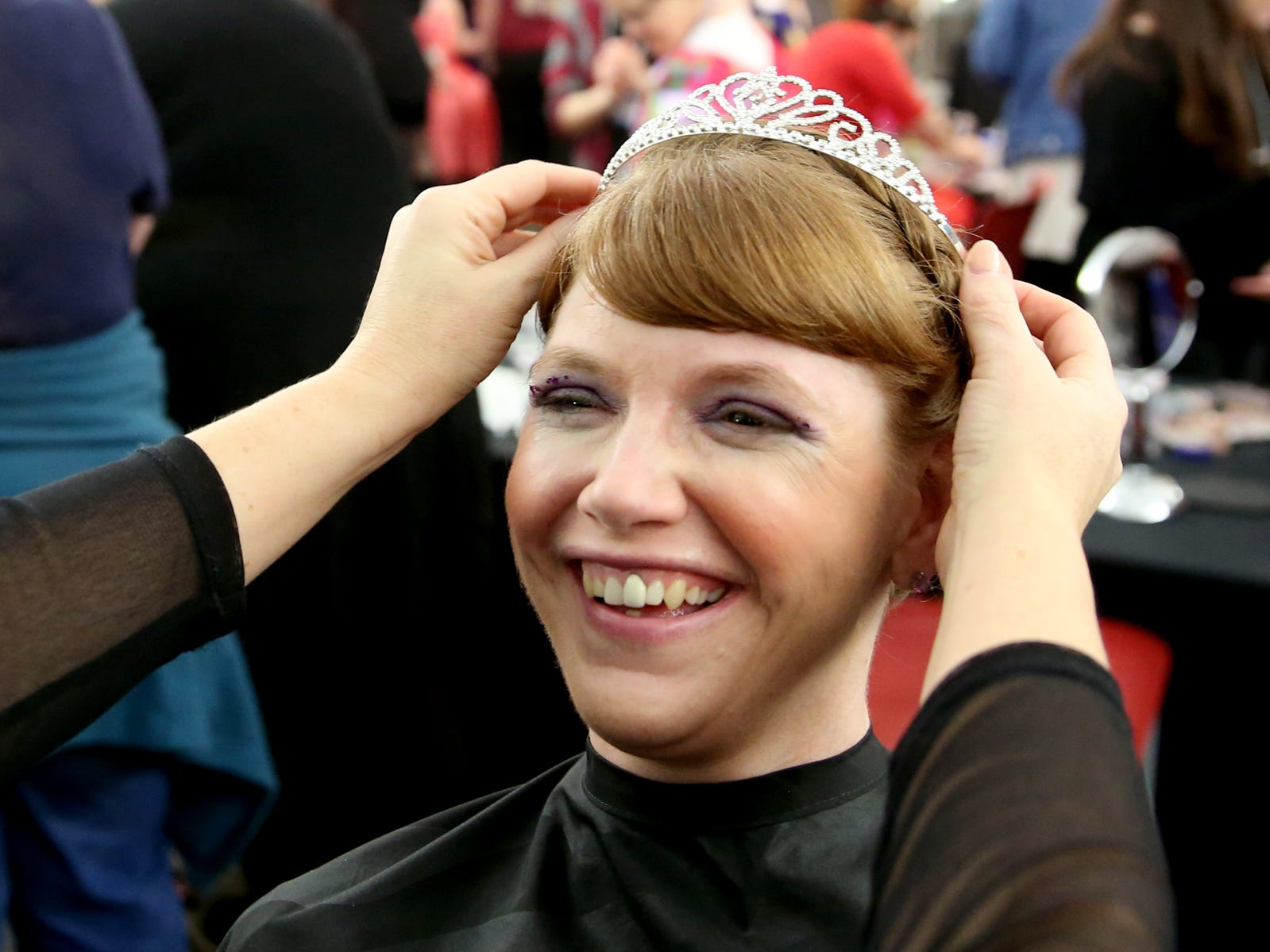 Kris Burden, 36, of Salem, has her hair done by volunteer Janna Reece at Night to Shine, a prom night experience for people with special needs, at Salem Alliance Church on Friday, Feb. 8, 2019.