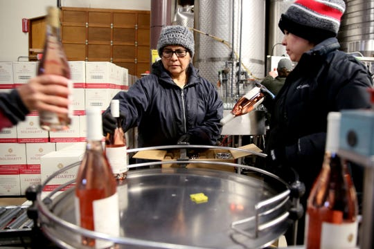Rosario Gomez, left, and Maria Almejo box up the first bottles of Oregon Solidarity wines after Oregon wineries teamed up to make wine from Oregon grapes a California winery rejected after wildfires. Photographed at Willamette Valley Vineyards near Turner on Friday, Feb. 8, 2019.