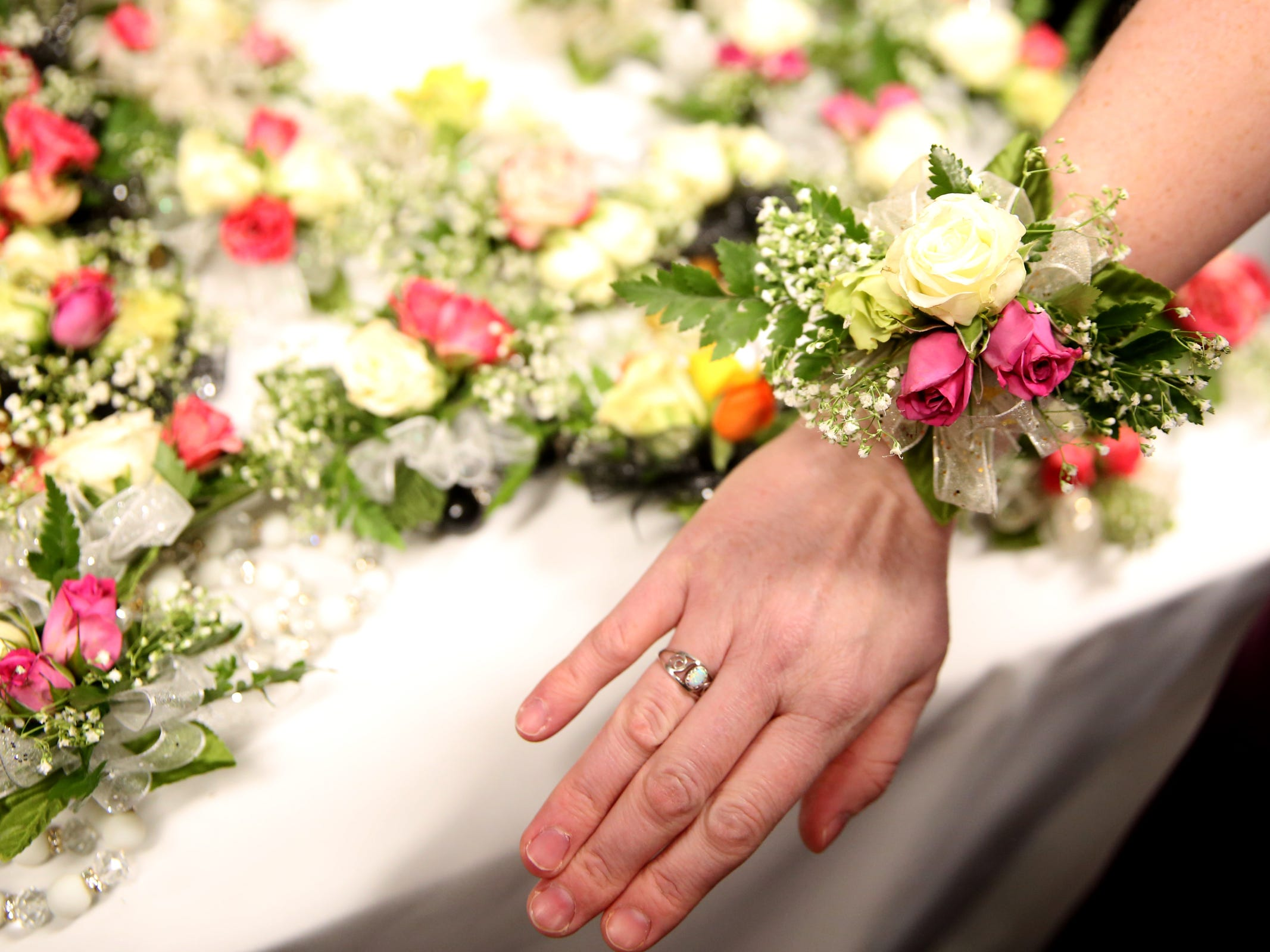 Kris Burden, 36, of Salem, picks out a corsage at Night to Shine, a prom night experience for people with special needs, at Salem Alliance Church on Friday, Feb. 8, 2019.