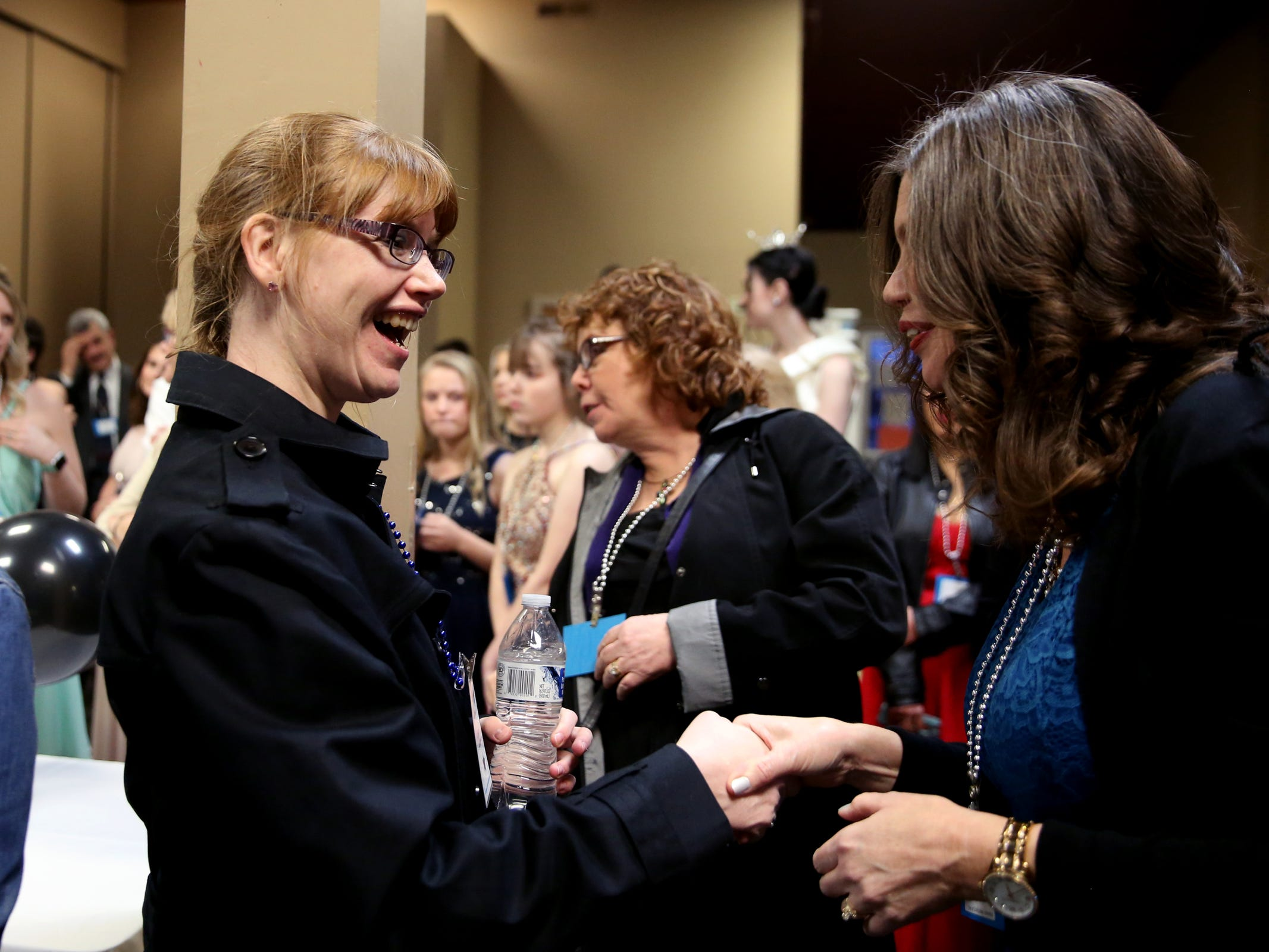 Kris Burden, left, 36, of Salem, meets her designated partner, Joy Biondi, of Keizer, during Night to Shine, a prom night experience for people with special needs, at Salem Alliance Church on Friday, Feb. 8, 2019.
