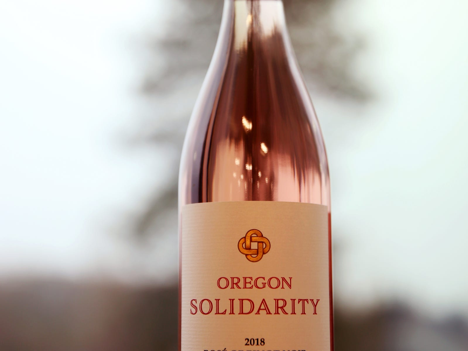 A bottle of Oregon Solidarity wine, created after Oregon wineries teamed up to make wine from Oregon grapes a California winery rejected after wildfires. Photographed at at the Statesman Journal in Salem on Friday, Feb. 8, 2019.