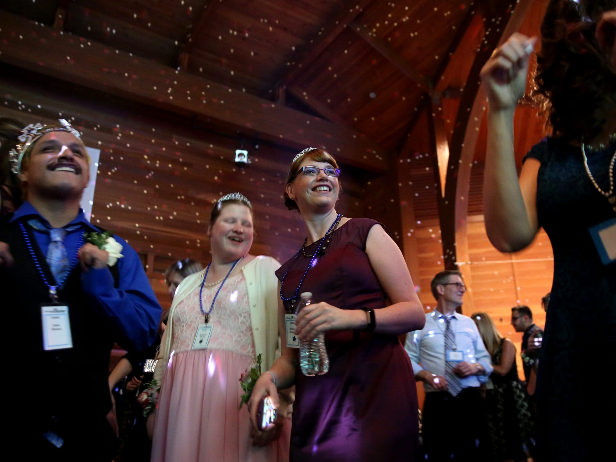 Kris Burden, center, 36, of Salem, dances with friends at Night to Shine, a prom night experience for people with special needs, at Salem Alliance Church on Friday, Feb. 8, 2019.