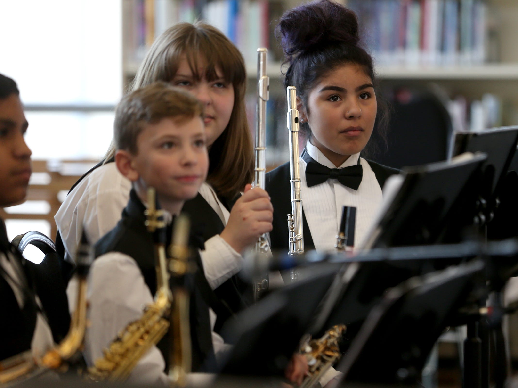 Parish Middle School jazz band students listen to feedback on their performance at the annual West Salem Jazz Festival at West Salem High School on Saturday, Feb. 9, 2019.