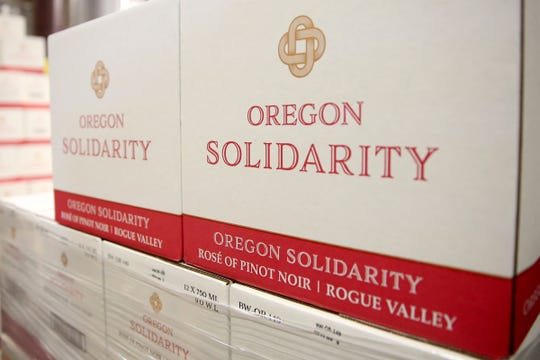 The first of Oregon Solidarity wines are being bottled after Oregon wineries teamed up to make wine from Oregon grapes a California winery rejected after wildfires. Photographed at Willamette Valley Vineyards near Turner on Friday, Feb. 8, 2019.